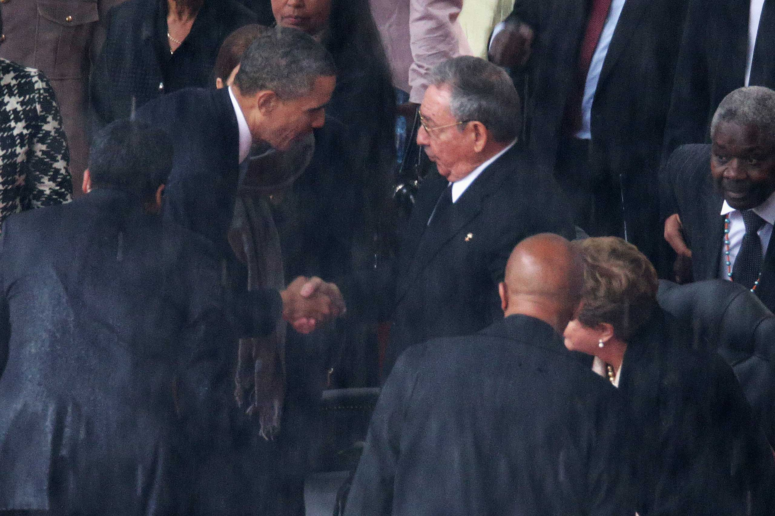 President Barack Obama shakes hands with Cuban President Raul Castro during the official memorial service for former South African President Nelson Mandela at FNB Stadium, Dec. 10, 2013 in Johannesburg, South Africa.