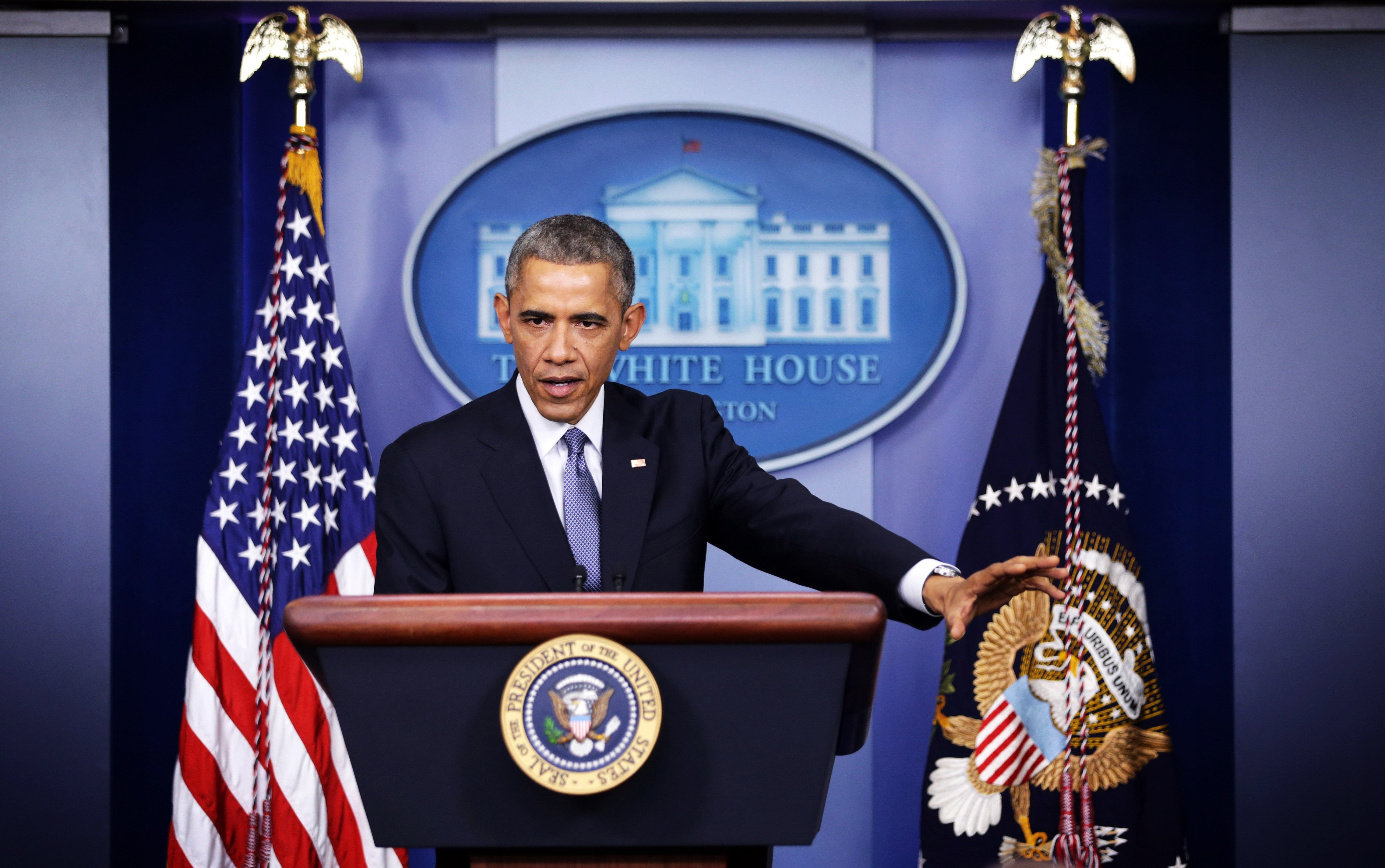 WASHINGTON, DC - DECEMBER 19:  U.S. President Barack Obama speaks during his speech to members of the media during his last news conference of the year in the James Brady Press Briefing Room of the White House December 19, 2014 in Washington, DC. President Obama faced questions on various topics including the changing of Cuba policy, his executive action on immigration and the Sony hack.  (Photo by Alex Wong/Getty Images)