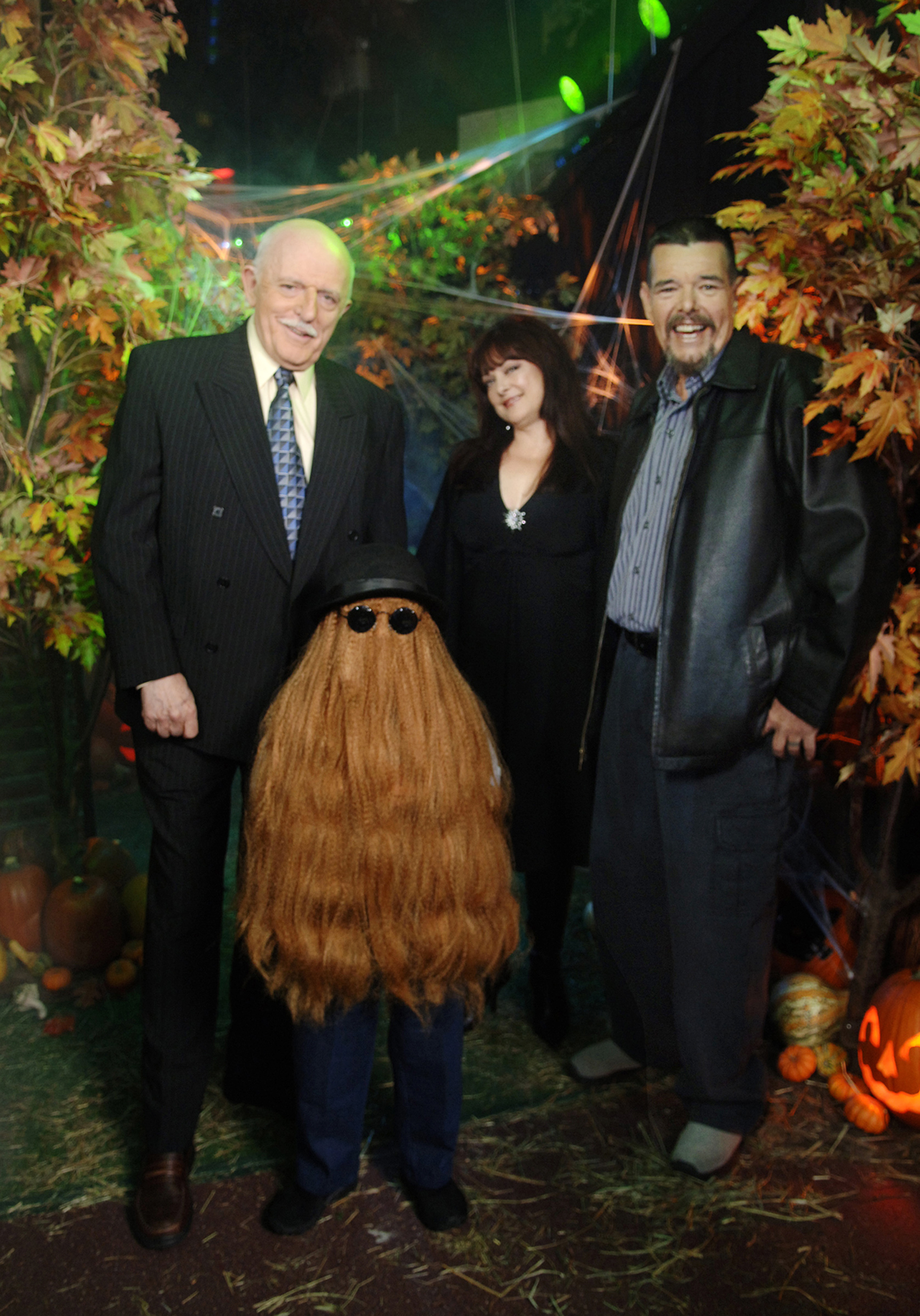 This Oct. 31, 2006, photo provided by ABC, shows some of the original cast of the TV show The Addams Family. From left: John Astin (Gomez Addams), Felix Silla (Cousin Itt), Lisa Loring (Wednesday Addams) and Ken Weatherwax (Pugsley Addams) reunited at a special Halloween edition of ABC's Good Morning America outside their Times Square studios in New York City