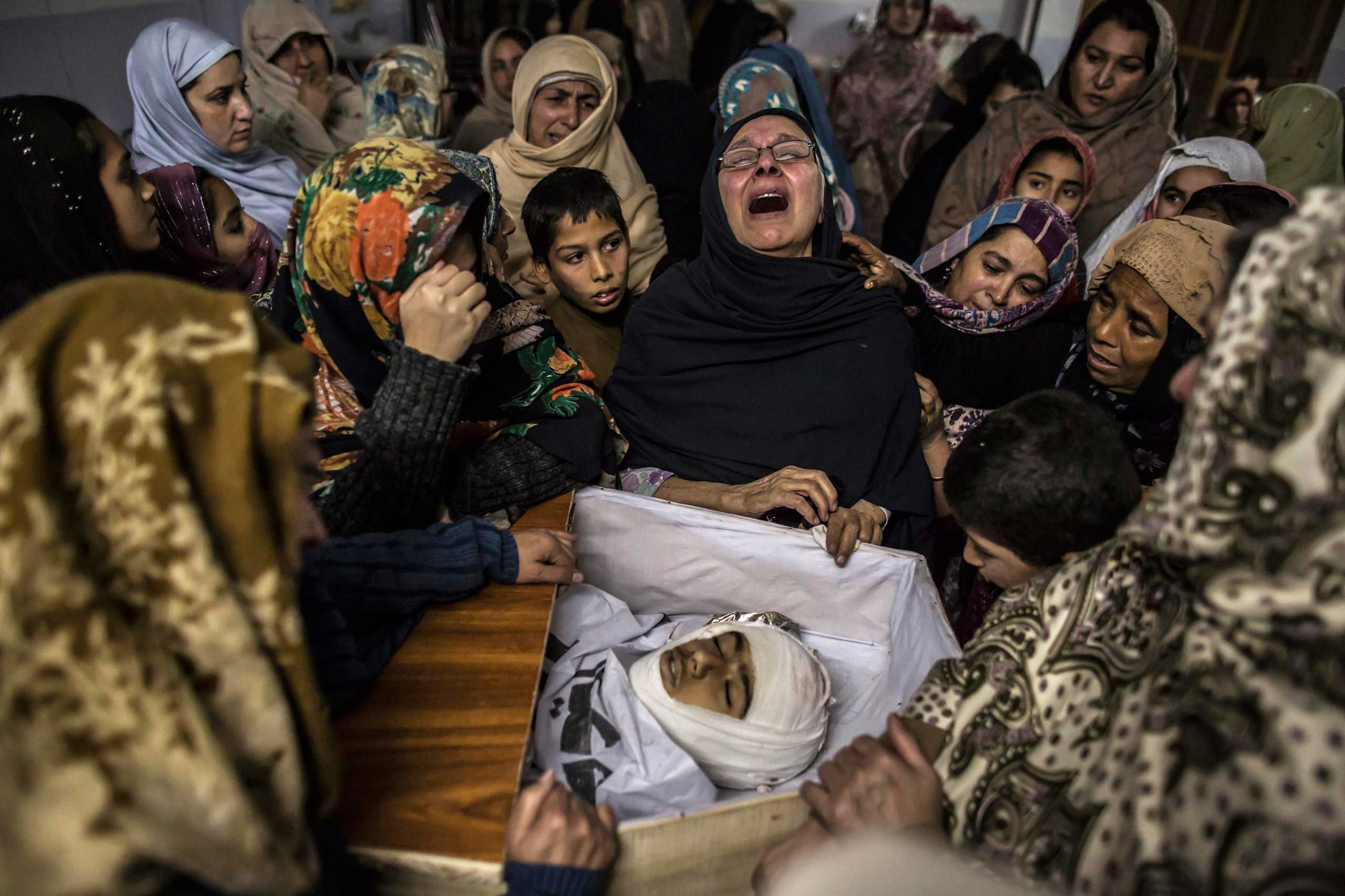 Women mourn their relative Mohammed Ali Khan, 15, a student who was killed during an attack by Taliban gunmen on the Army Public School, at his house in Peshawar, Dec. 16, 2014.