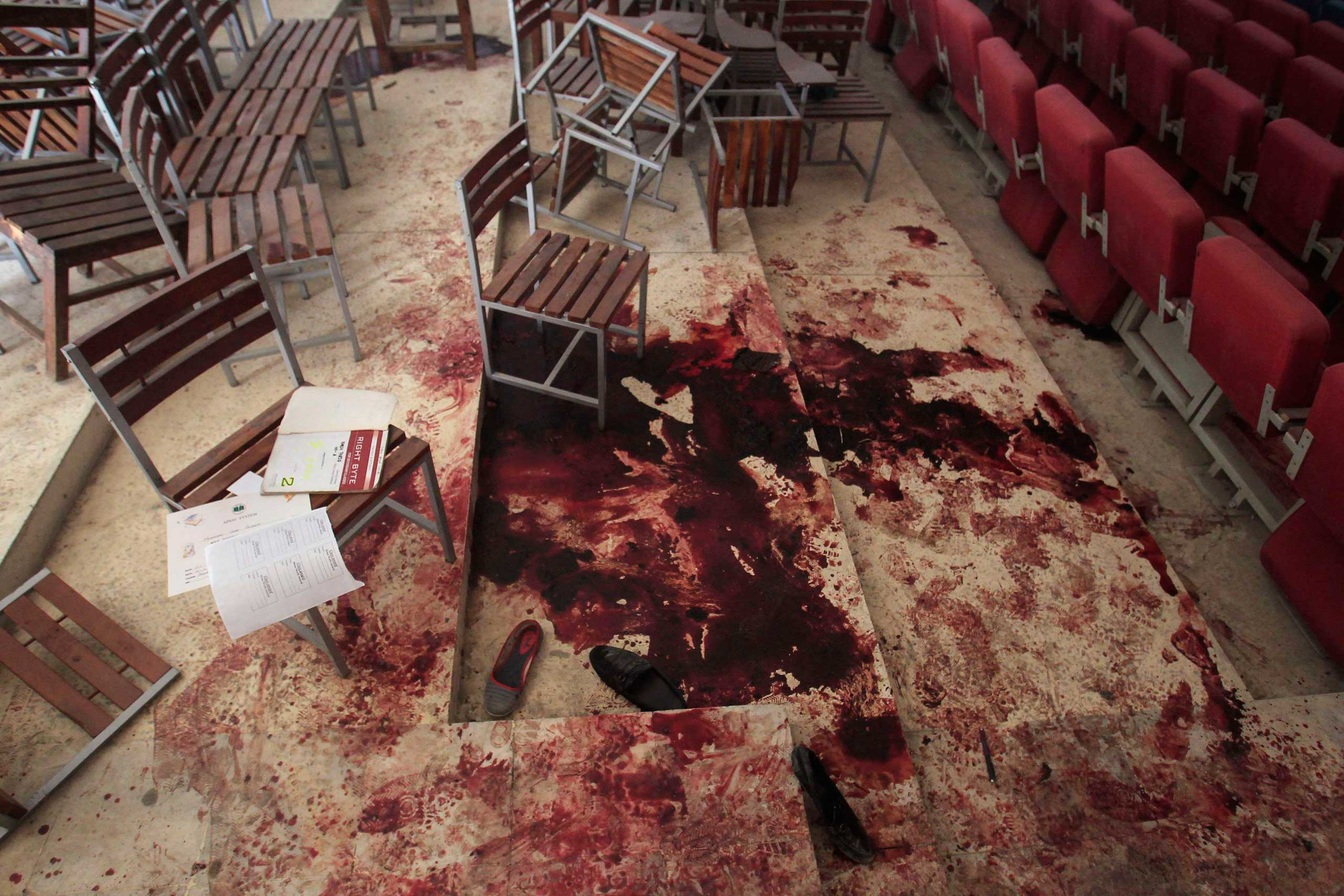 Shoes lie in blood on the auditorium floor at the Army Public School, which was attacked by Taliban gunmen, in Peshawar, Dec. 17, 2014.