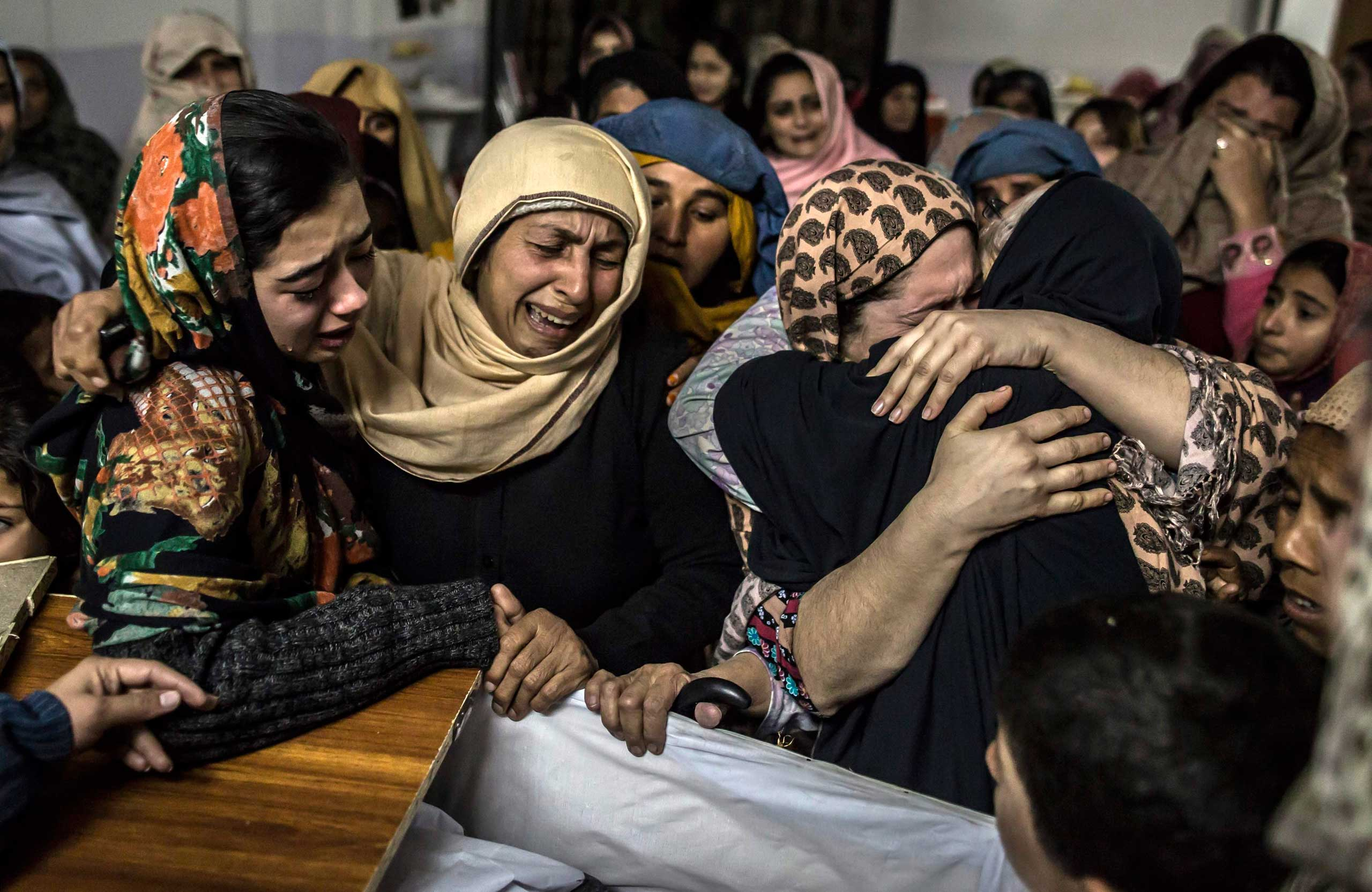 Dec. 16, 2014. Women mourn their relative Mohammed Ali Khan, 15, a student who was killed during an attack by Taliban gunmen on the Army Public School, at his house in Peshawar Pakistan. At least 132 students and nine staff members were killed after Taliban gunmen broke into a school in the Pakistani city of Peshawar and opened fire.