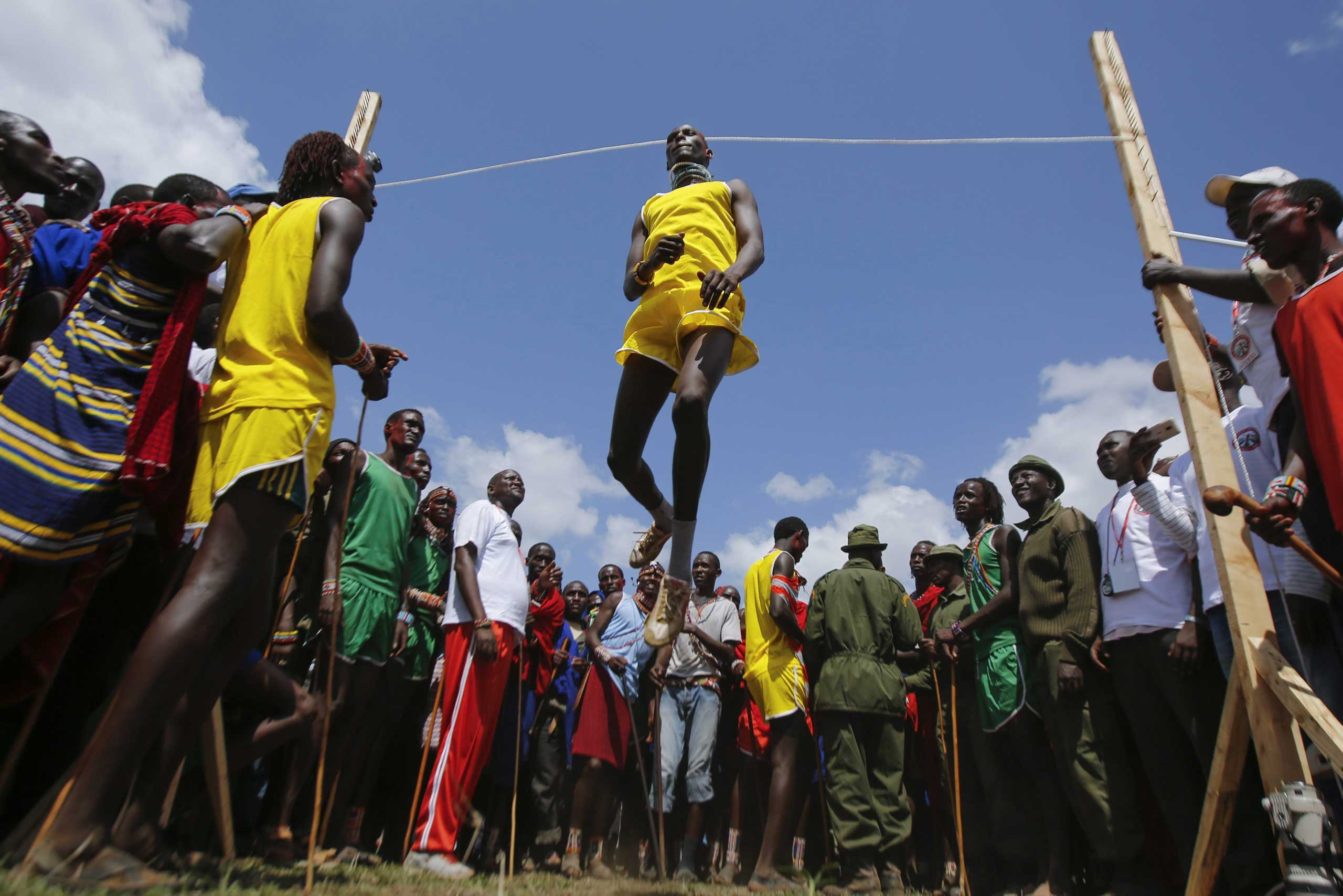 Dec. 13, 2014. A young Maasai man competes in the High Jumping competition at the Maasai Olympics 2014, held in Kimana village near the border with Tanzania adjacent to the Amboseli National Park in Kenya.The Maasai Olympics, first held in 2012, was organized by Maasai leaders and the wildlife conservation group 'Big Life Foundation' to stop the killings of lions and other wild animals. The event aims to change the mindset of young Maasai men whose traditional lion hunting has been an important coming-of-age ritual.