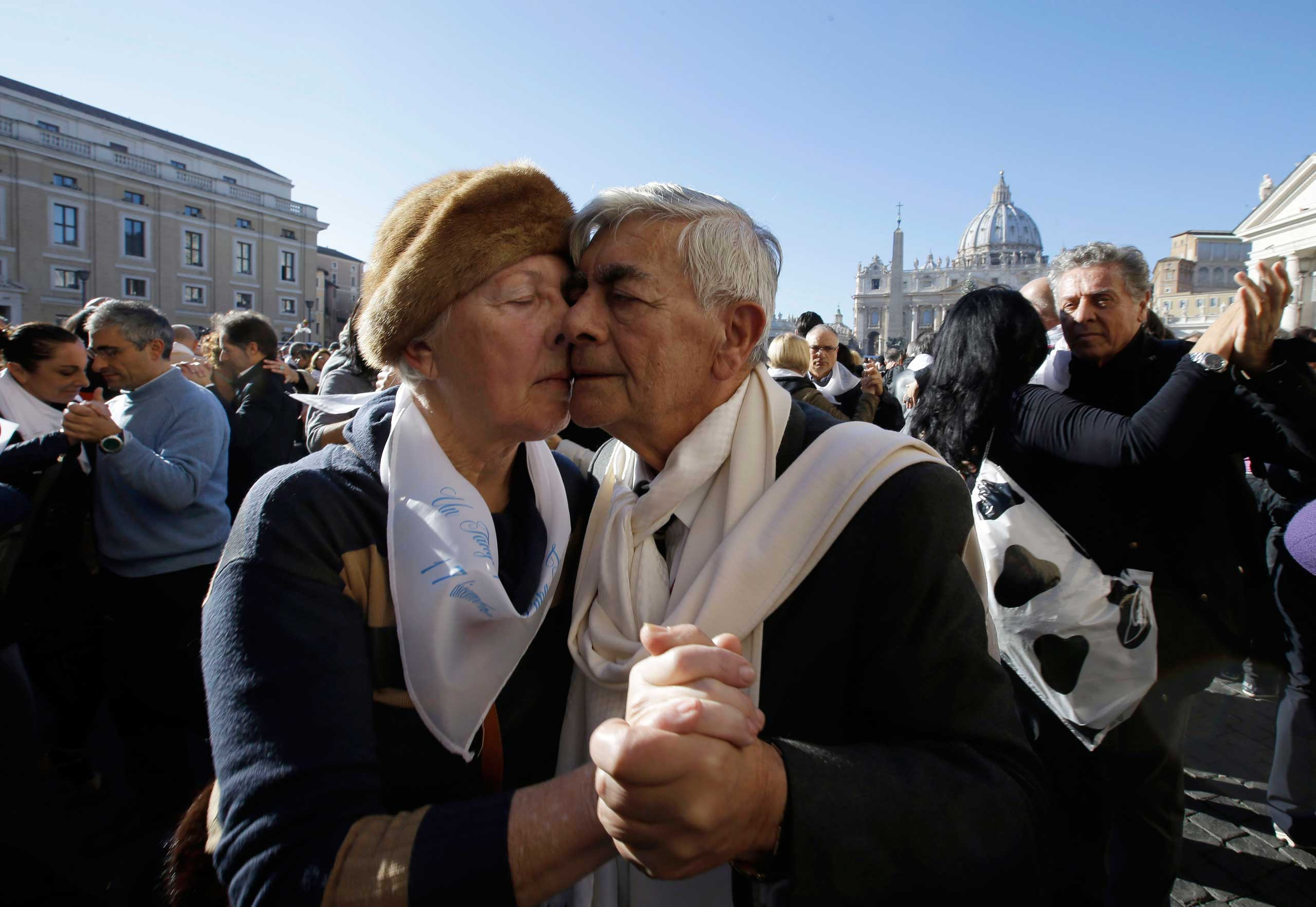 Dec. 17, 2014. A couple dance the tango in front of St. Peter's Square to celebrate Pope Francis 78th birthday, at the Vatican.