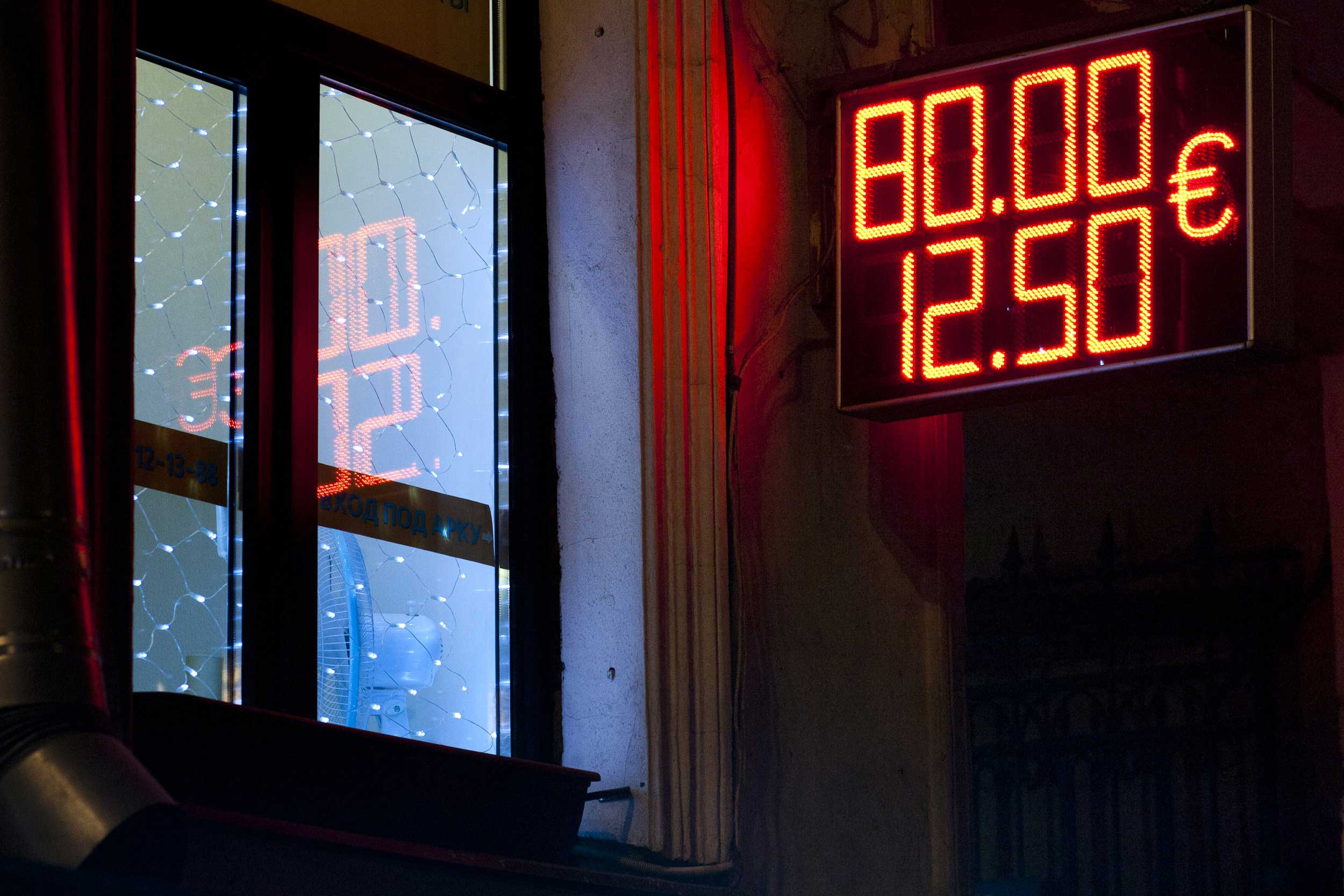 Dec. 16, 2014. Russian currency dropped to 100 rubles to one euro, more then 25 per cent per a day. The continued drop in the price of crude oil and Western sanctions against Russia over the Ukraine crisis are being blamed for plunging the rouble to a record low against dollar and euro.