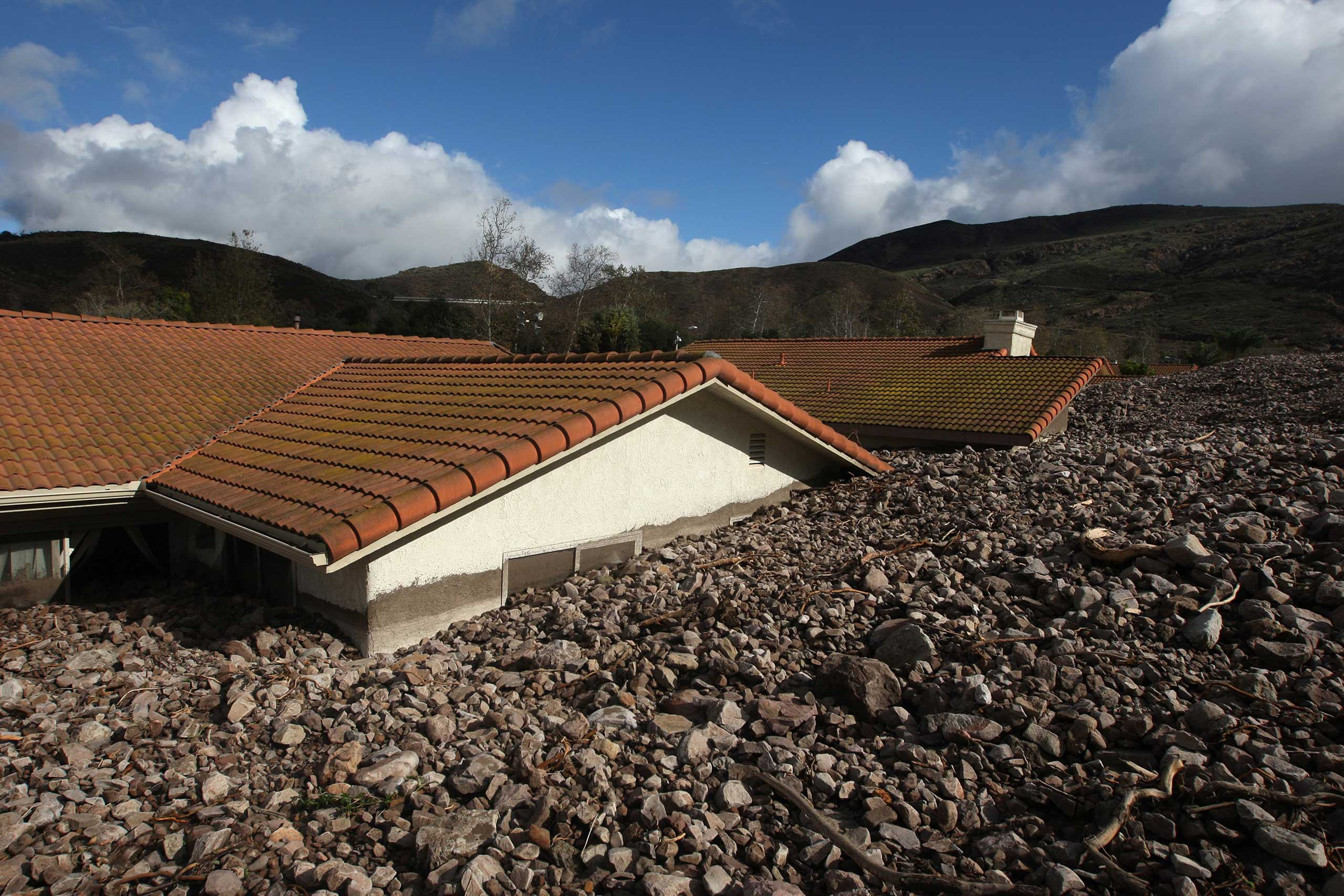 Dec. 12, 2014.  Homes are covered with rocks and mud after debris flows smashed into houses as a powerful storm in the Camarillo Springs neighborhood of Camarilla, California.