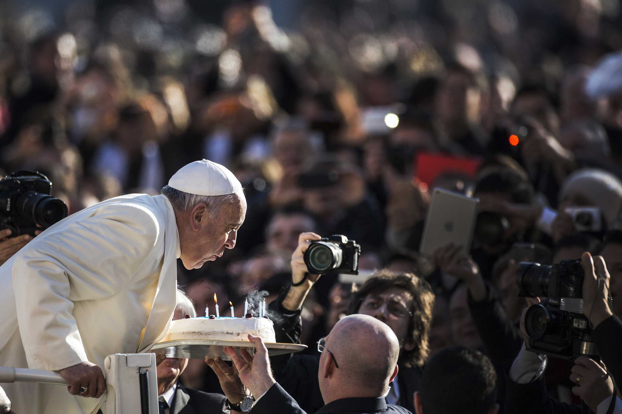 Dec. 17, 2014. Pope Francis blows out candles on a birthday cake on the occasion of his 78th birthday during his weekly general audience in St. Peter's Square at the Vatican.