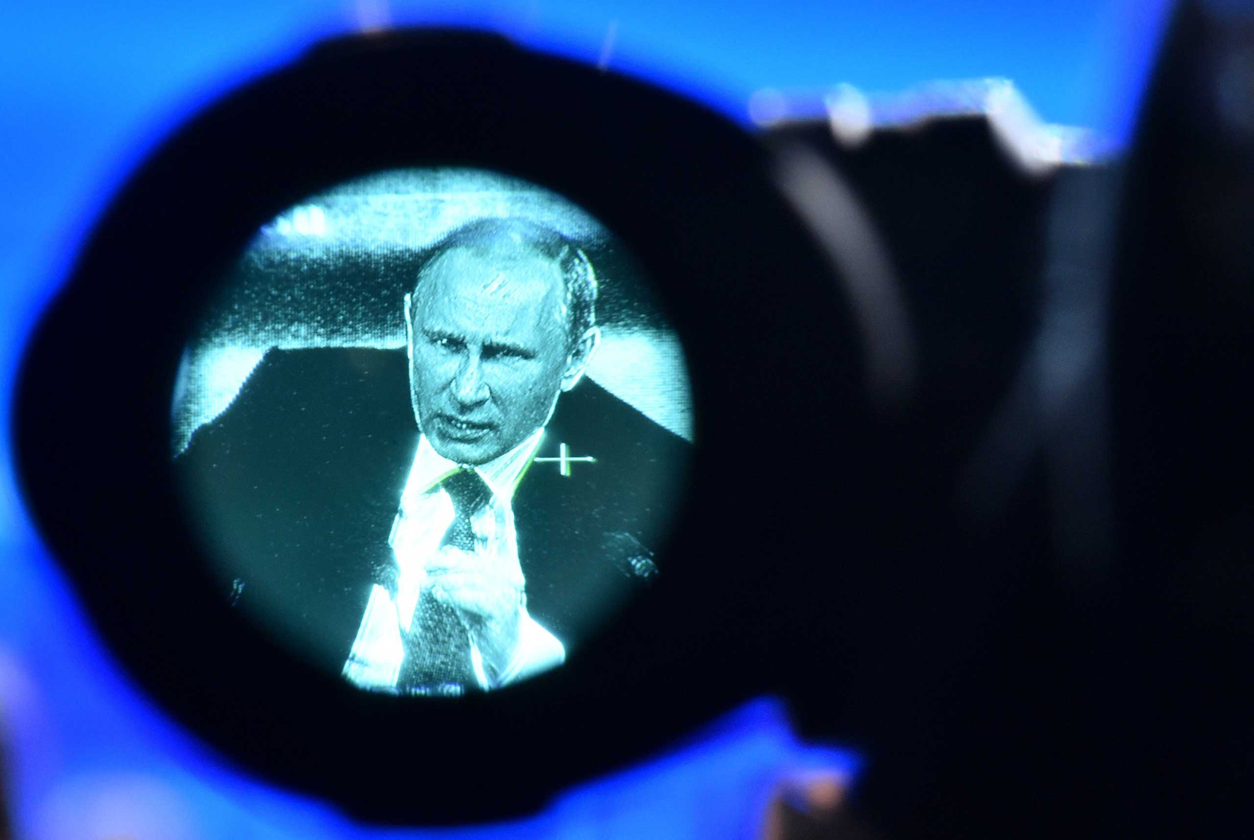 Dec.18, 2014. Russia's President Vladimir Putin is seen through a video camera's viewfinder, as he speaks during his annual press conference in Moscow.