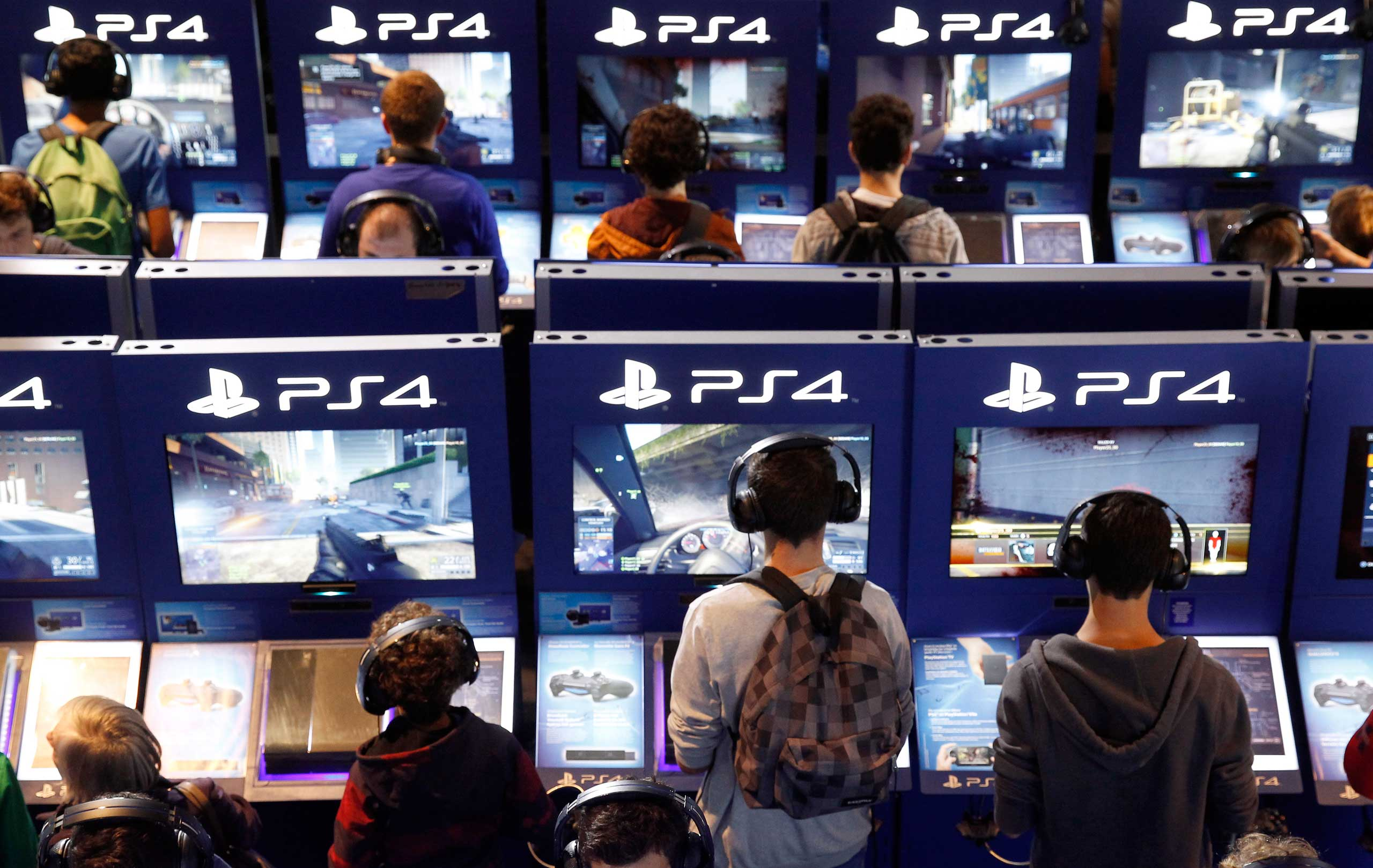 Gamers play video games with Playstation PS4 consoles during the International Games Week in Paris on Oct. 29, 2014.