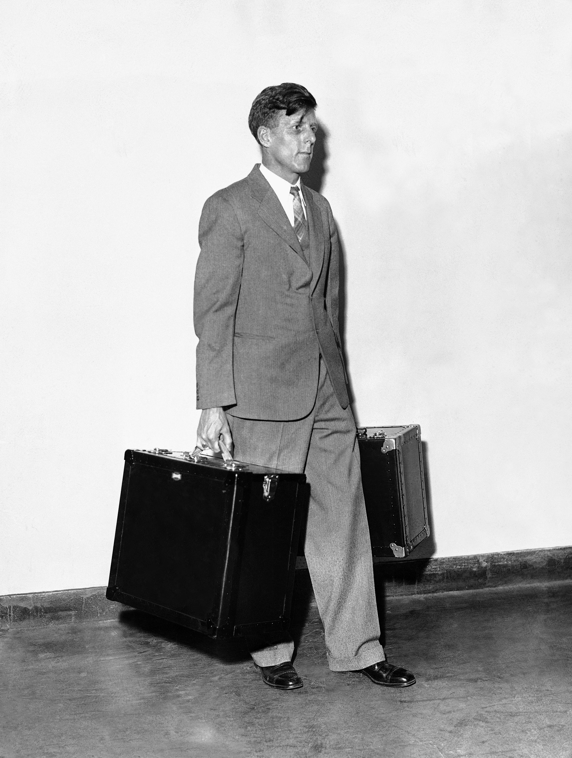 A man carries AP's portable WirePhoto transmitter.