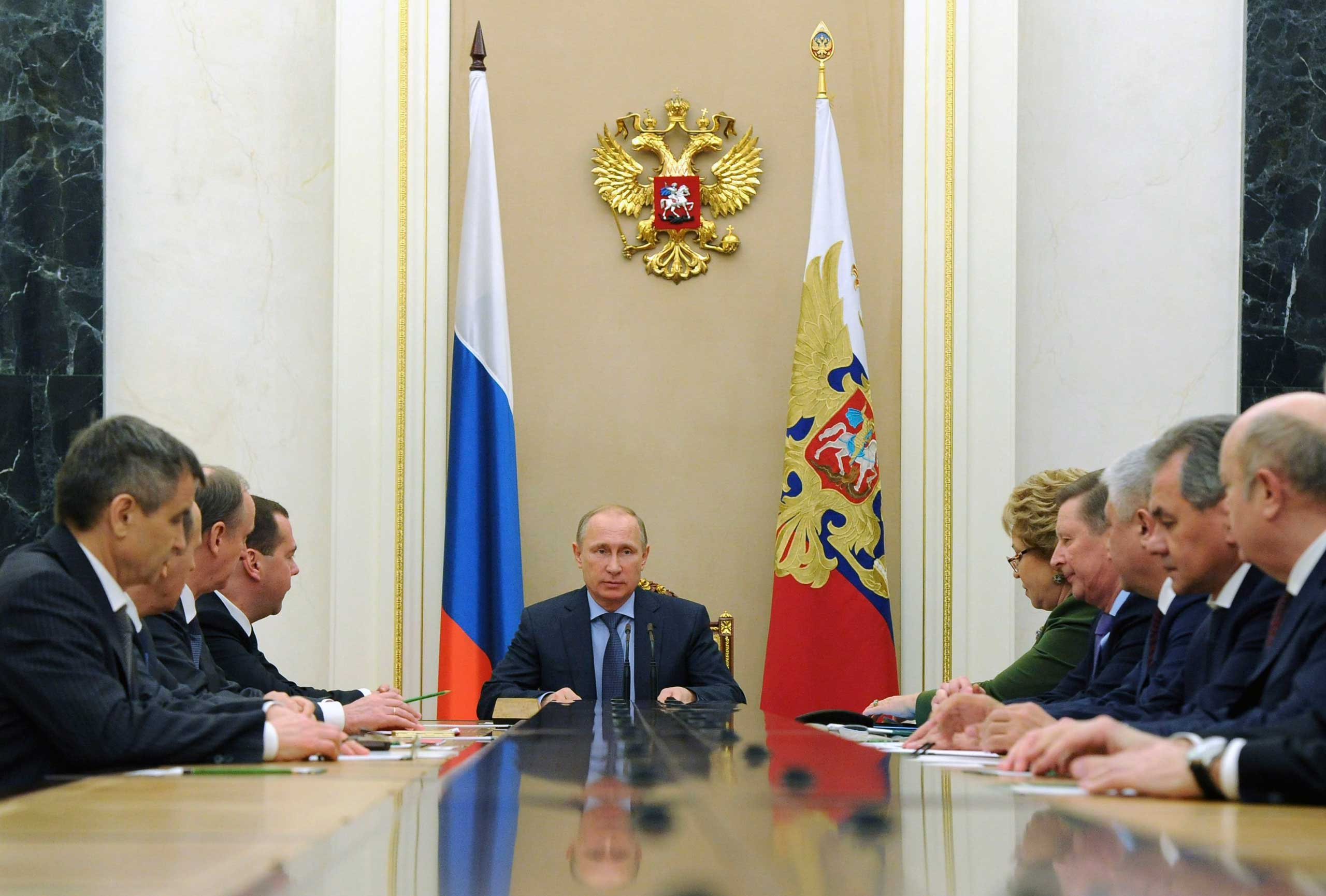 Russia's President Vladimir Putin (C) chairs a meeting with permanent members of the Security Council at the Kremlin in Moscow, December 12, 2014.