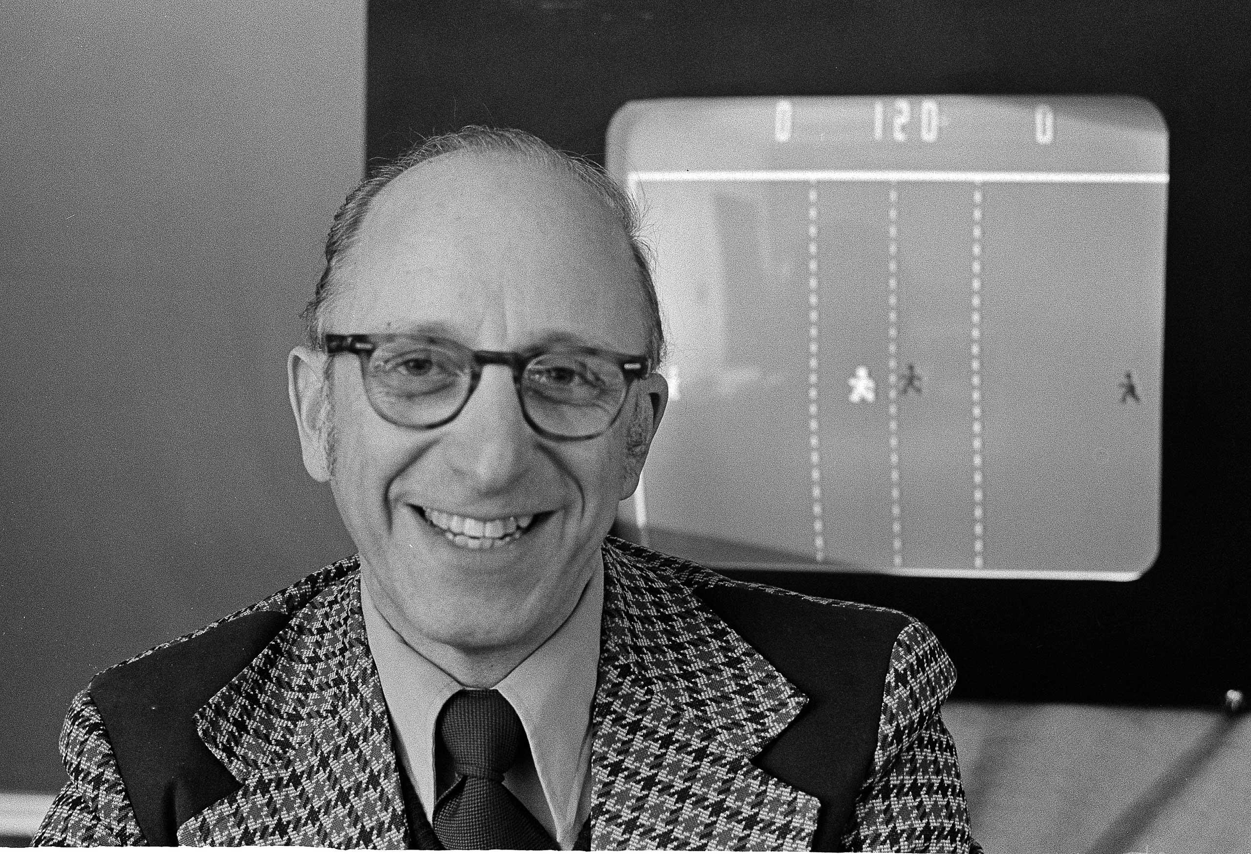 Ralph Baer an engineer for Sanders Associates, Inc., of Nashua, N.H. watches his TV hockey game on Feb. 3, 1977.