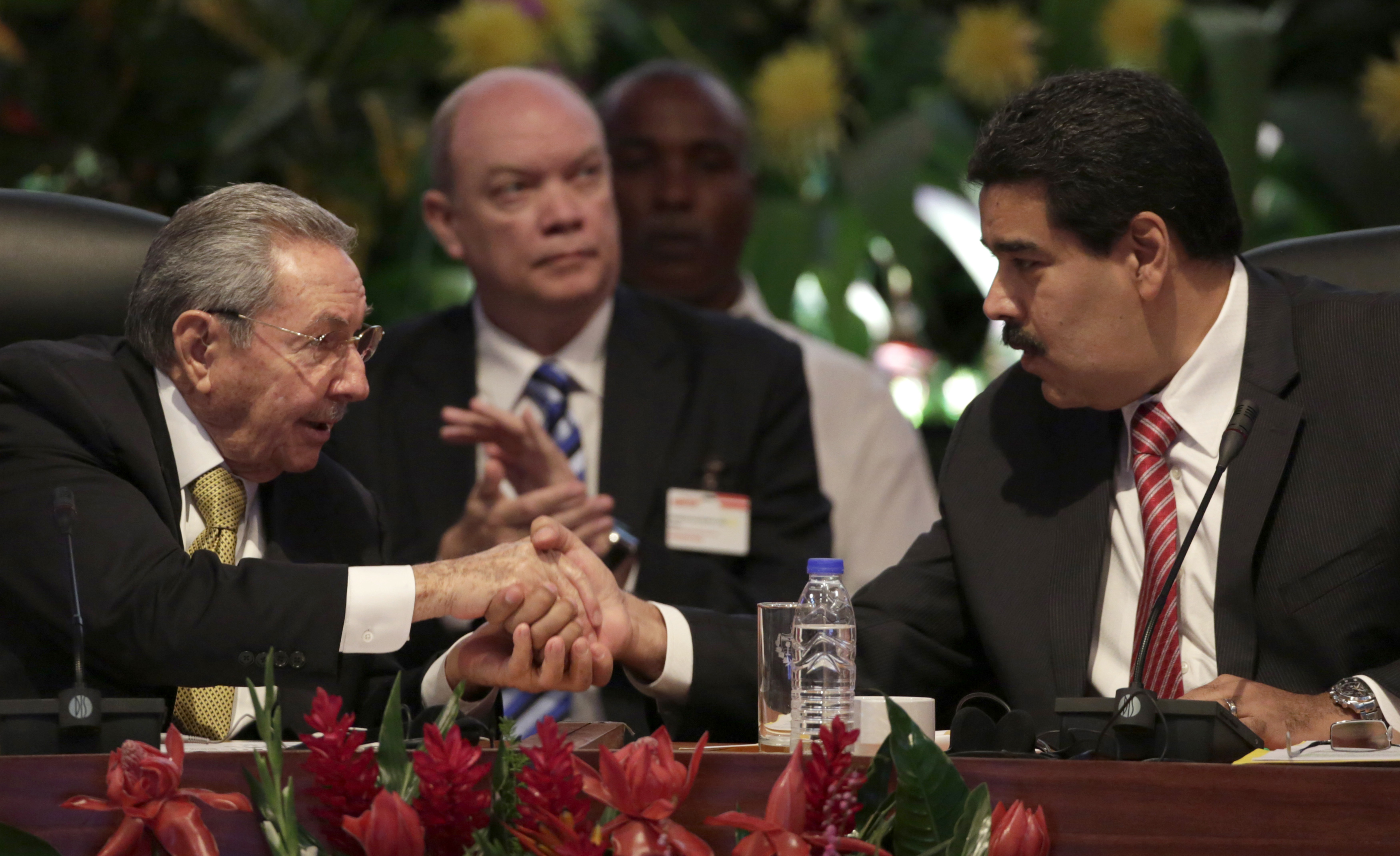 From Left: Cuba's President Raul Castro shakes hands with Venezuela's President Nicolas Maduro during the opening session of the 10th ALBA alliance summit in Havana on Dec. 14, 2014.