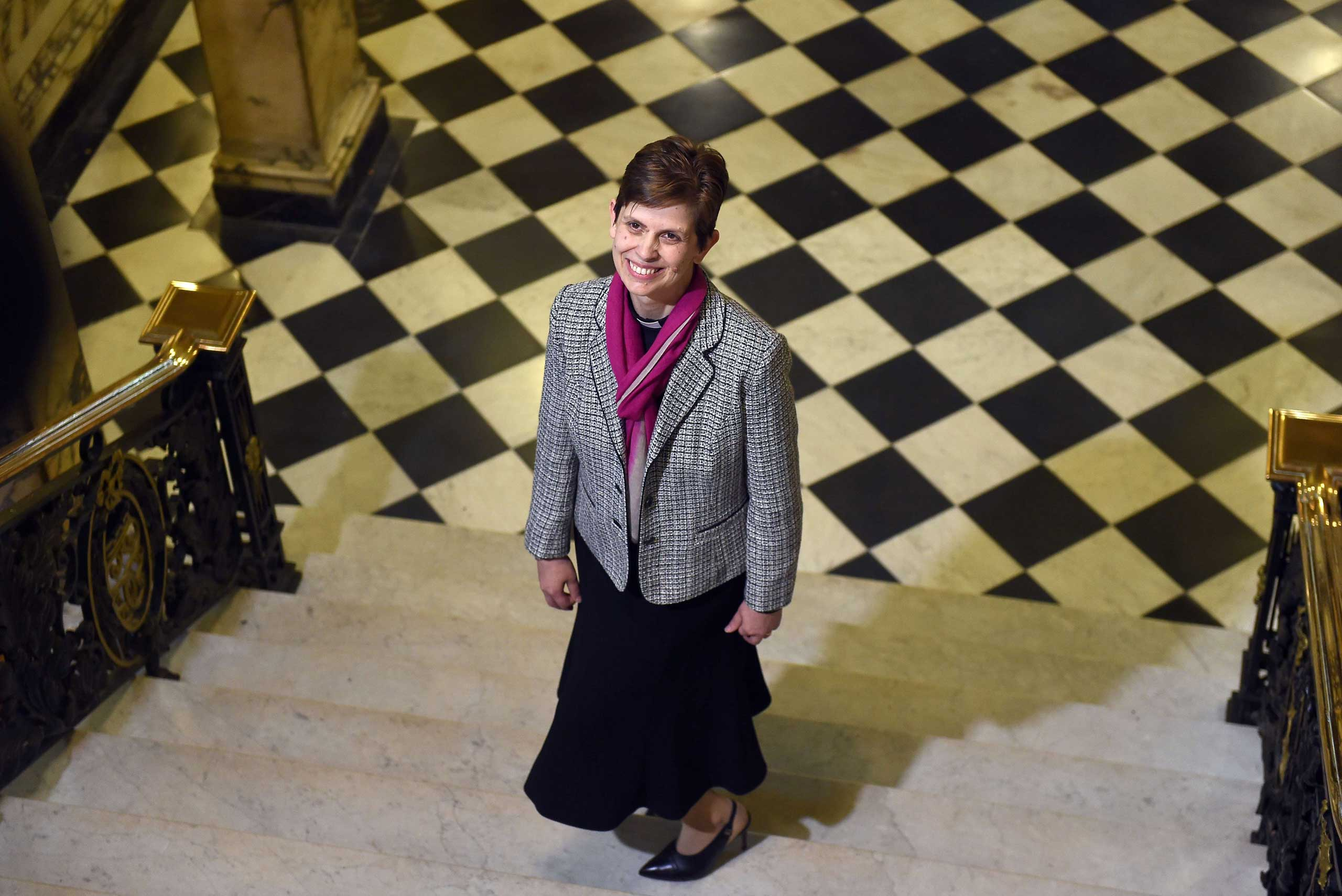 Reverend Libby Lane poses for pictures during a photo call following the announcement naming her first woman bishop by The Church of England, after a historic change in its rules, in Stockport, northwest England, on Dec. 17, 2014.