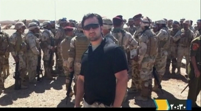 Iranian-American Amir Hekmati, who has been sentenced to death by Iran's Revolutionary Court on charges of spying for the CIA,  stands with Iraqi soldiers in this undated still image taken from video in an undisclosed location made available on Jan. 9, 2012