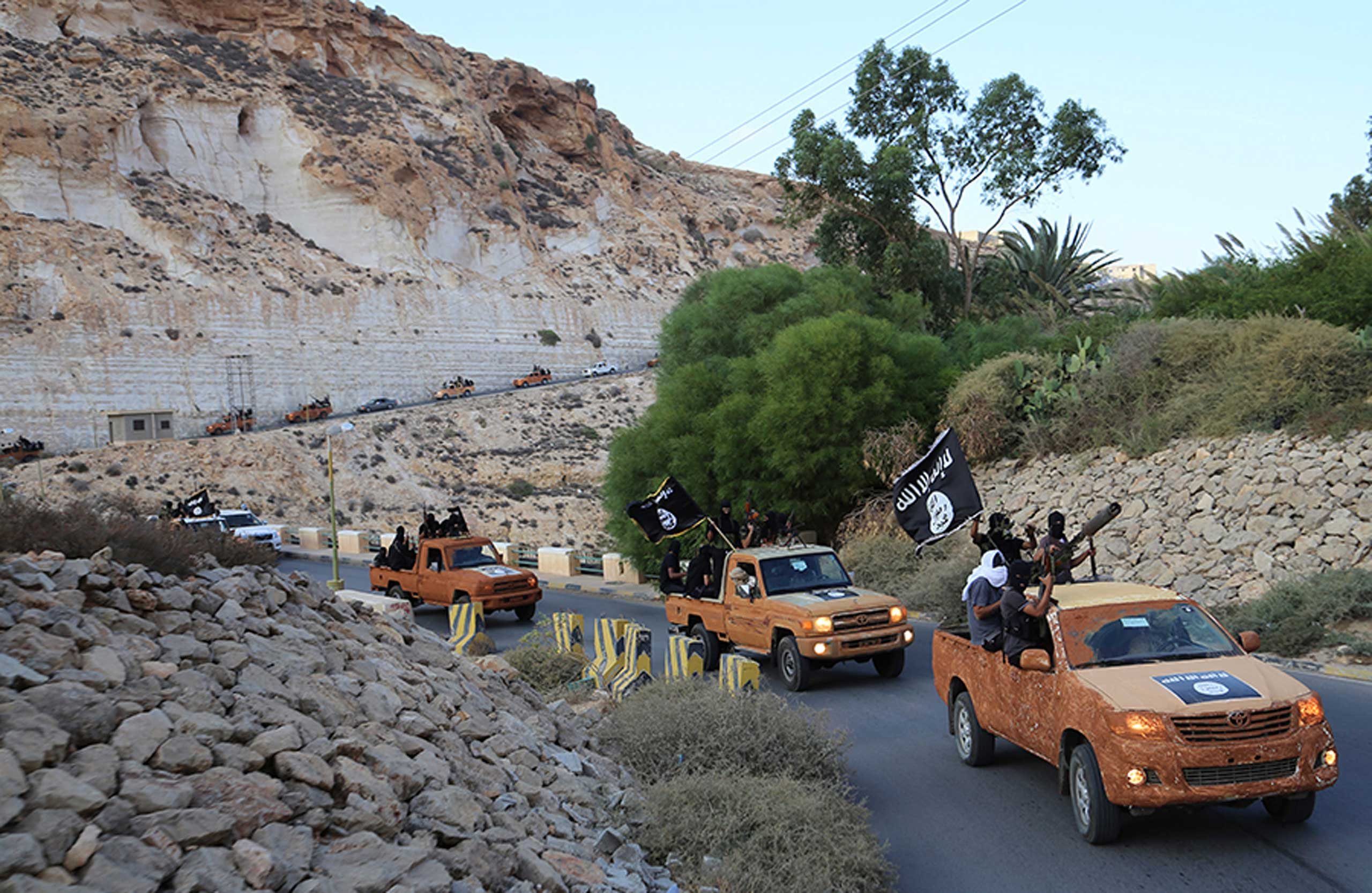 An armed motorcade belonging to members of Darna's Islamic Youth Council, which pledged allegiance to the Islamic State, drive along a road in Derna, eastern Libya, Oct. 3, 2014.