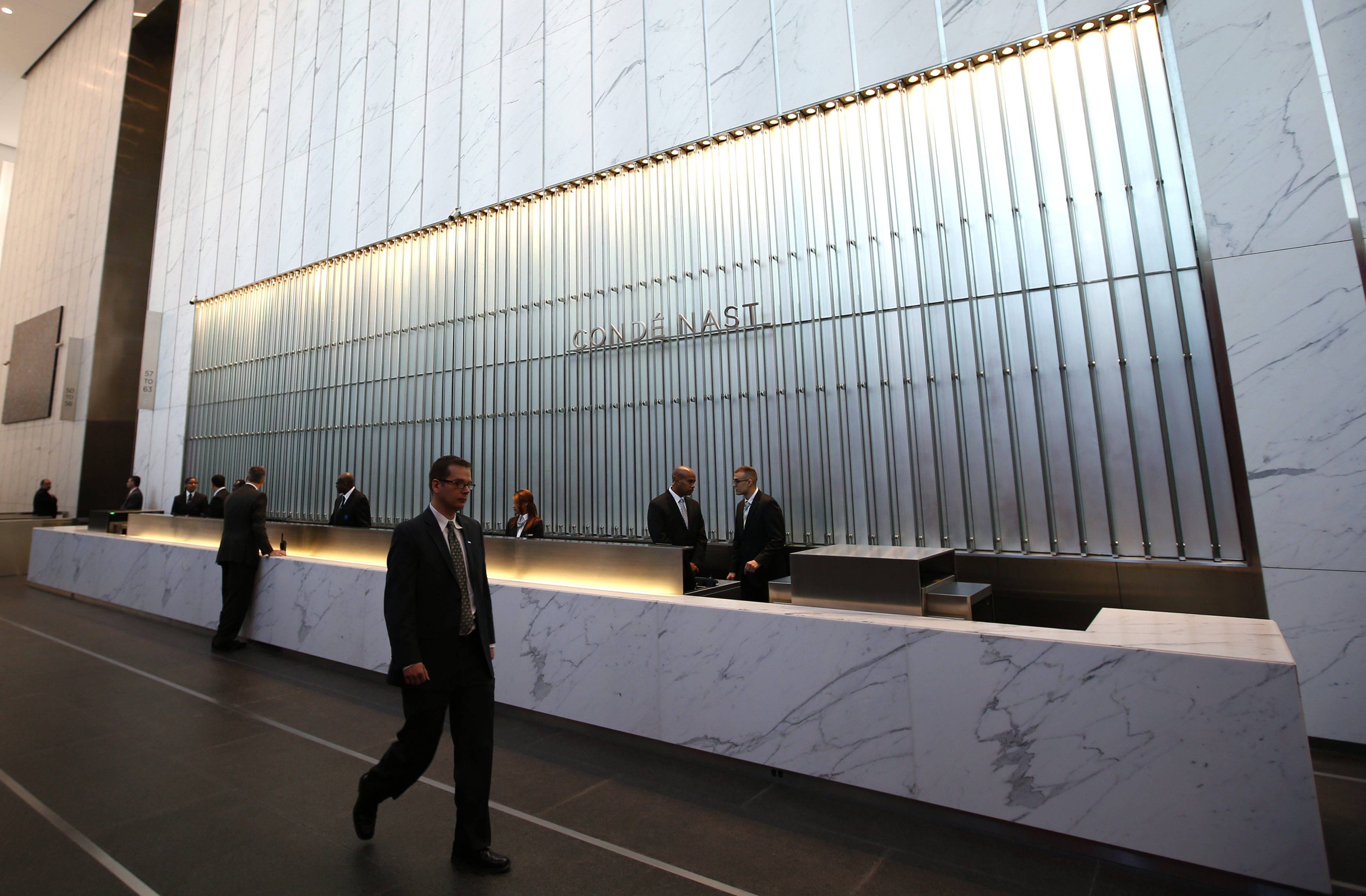 Condé  Nast employees work in the lobby of the One World Trade Center tower in New York City on Nov. 3, 2014