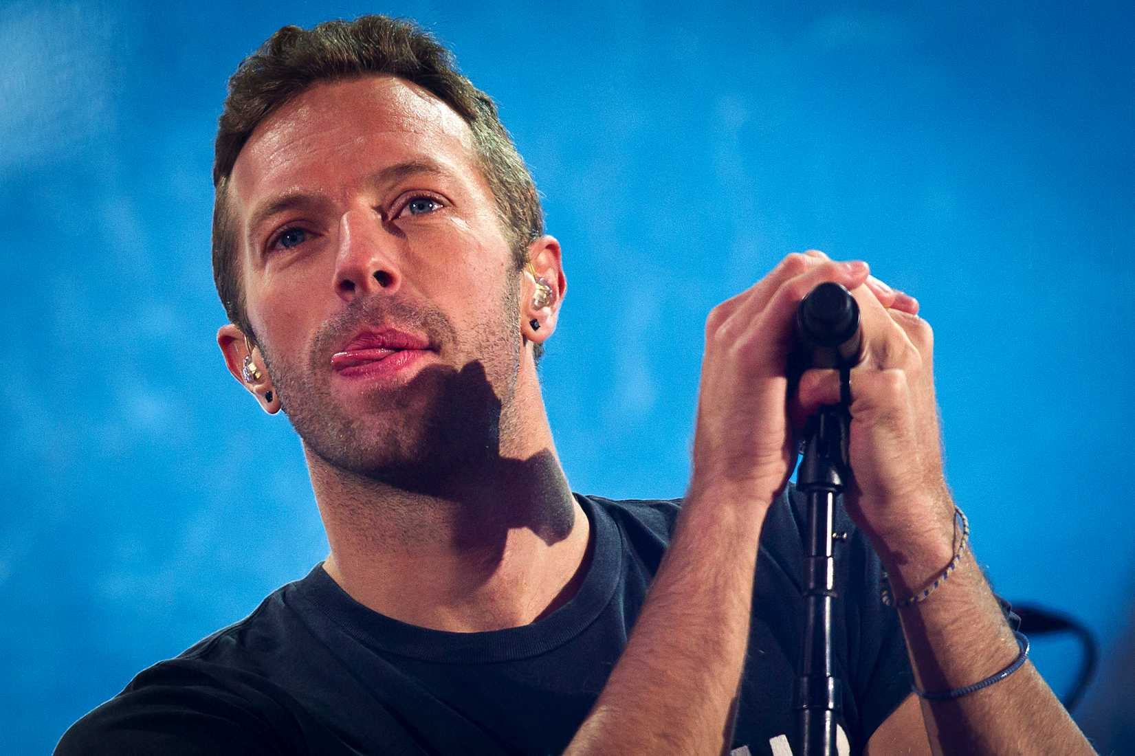 Chris Martin performs with U2 during a surprise concert in support of World AIDS Day in Times Square in New York City on Dec. 1, 2014