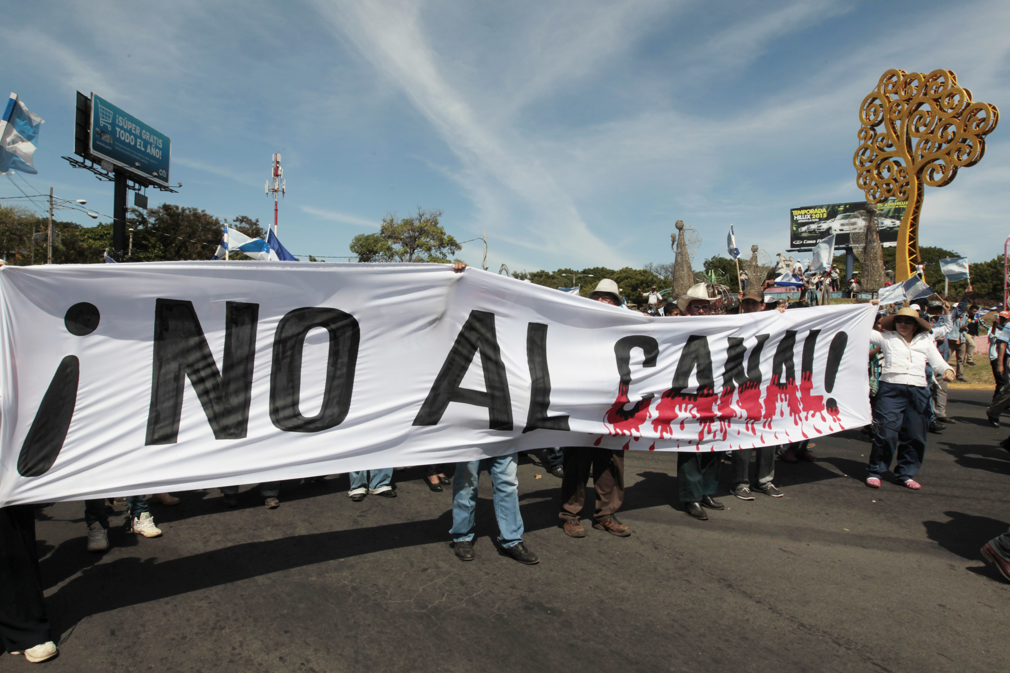Demonstrators hold a banner during a march to protest against the construction of the Interoceanic Grand Canal on Dec. 10, 2014, in Managua, Nicaragua