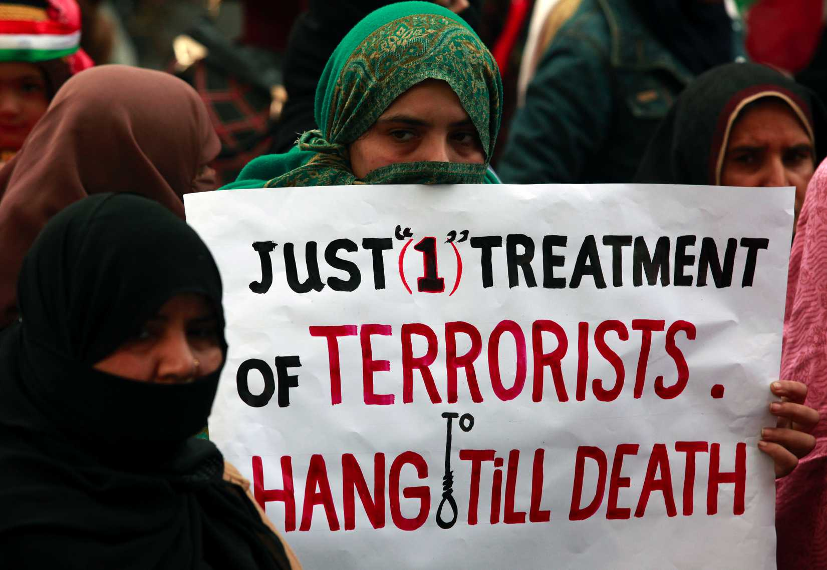 Demonstrators in the Pakistani city of Lahore on Dec. 21, 2014, condemn the attack by Taliban gunmen on the Army Public School in Peshawar