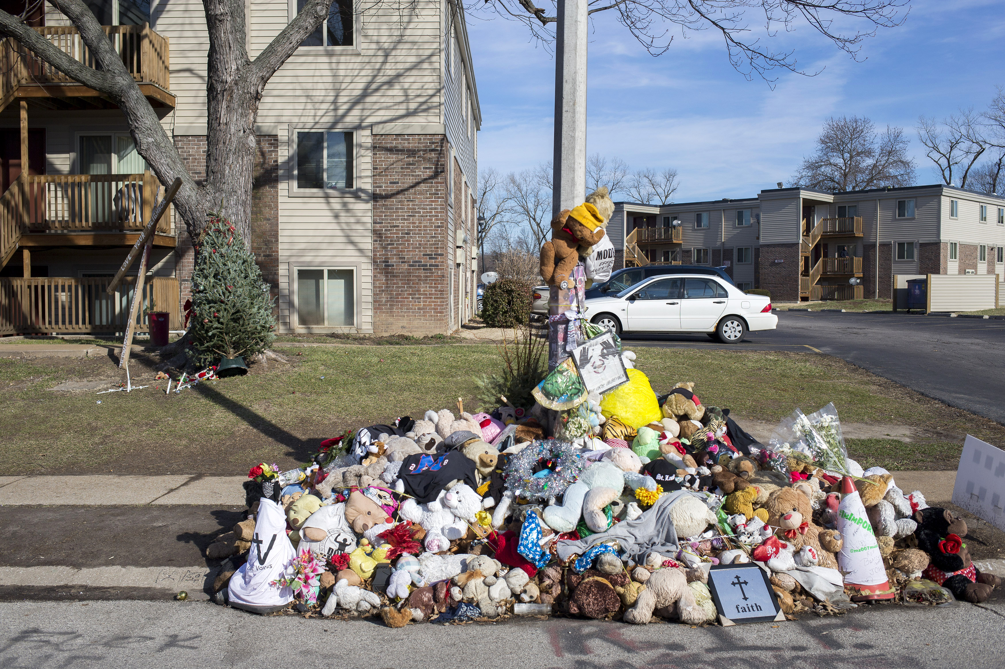 A Christmas tree is seen near a memorial to Michael Brown in Ferguson, Mo., on Dec. 25, 2014