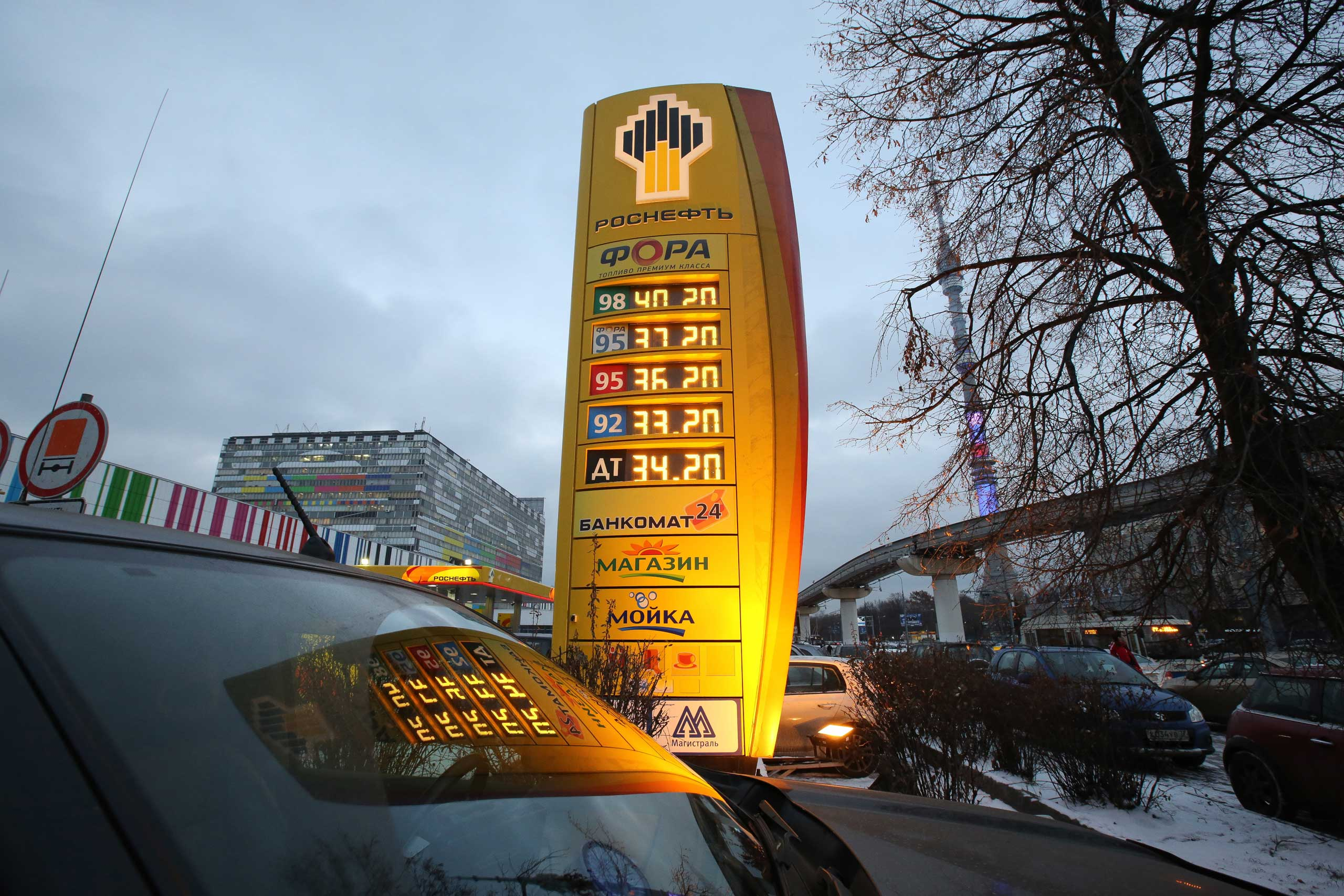 Ruble fuel prices sit on an illuminated electronic display board outside an OAO Rosneft gas station in Moscow, Dec. 2, 2014.