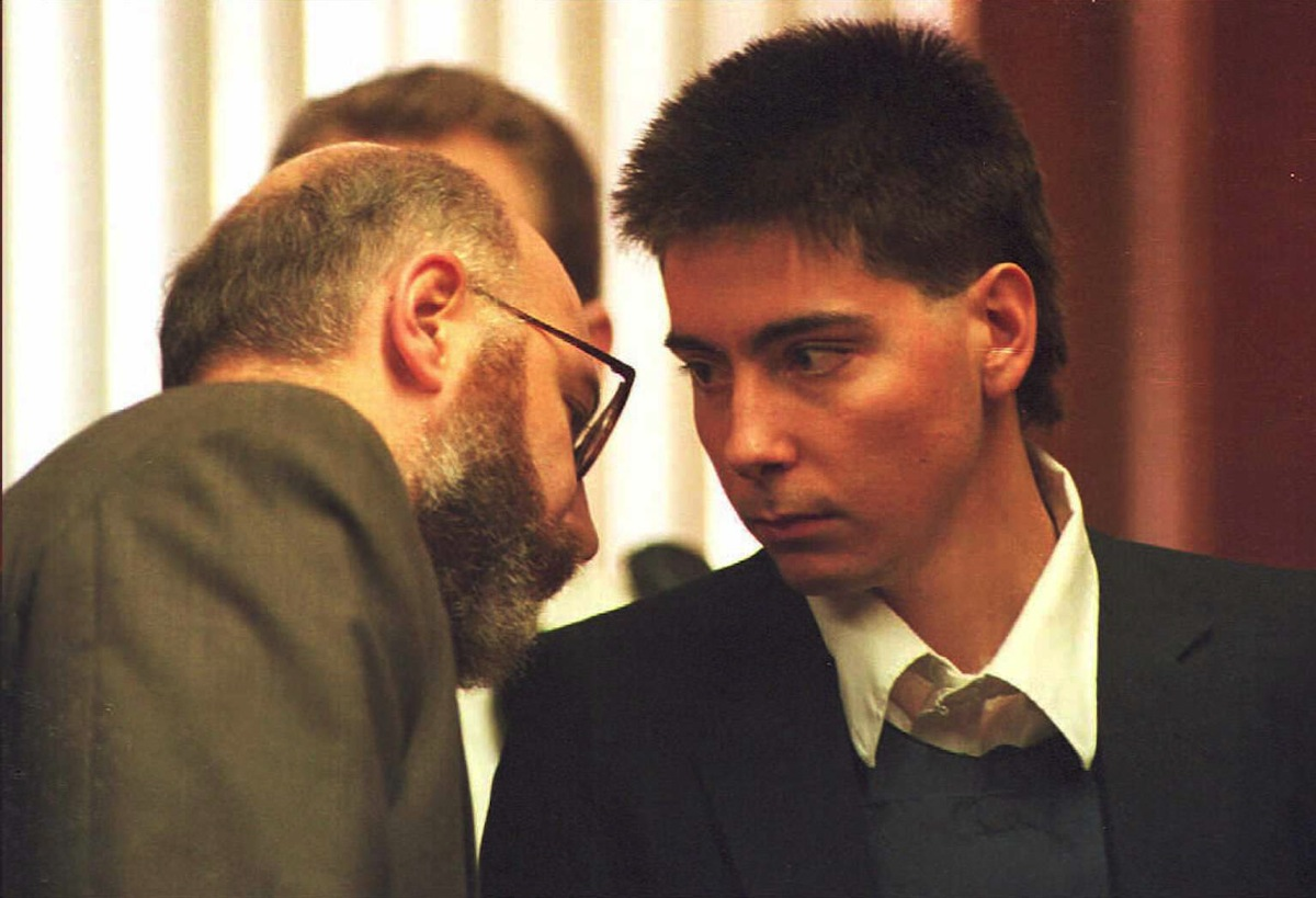 John C. Salvi, 3rd (R) speaks with his lawyer J. W. Carney during the Brookline District Court hearing where Salvi pleaded innocent to murder charges, in Brookline, Mass.