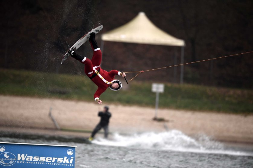 A man dressed as Santa Claus jumps over a barricade on a wakeboard on the Blauer See lake in Garbsen, Germany on Dec. 6, 2014.