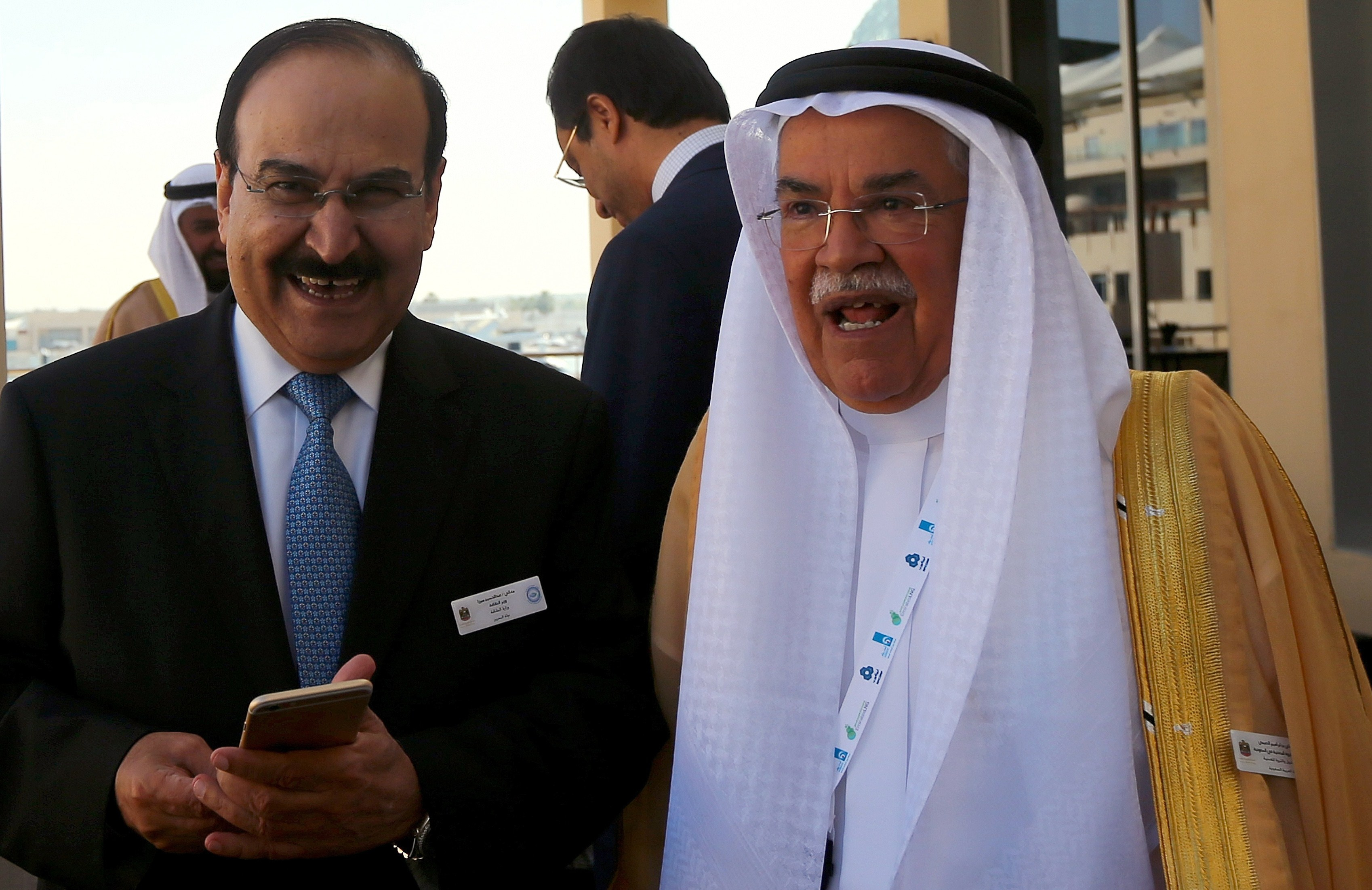 From left: Bahraini Oil Minister Abdulhussain bin Ali Mirza stands with Saudi Oil Minister Ali al-Naimi during the 10th Arab Energy Conference in Abu Dhabi, on Dec. 21, 2014.