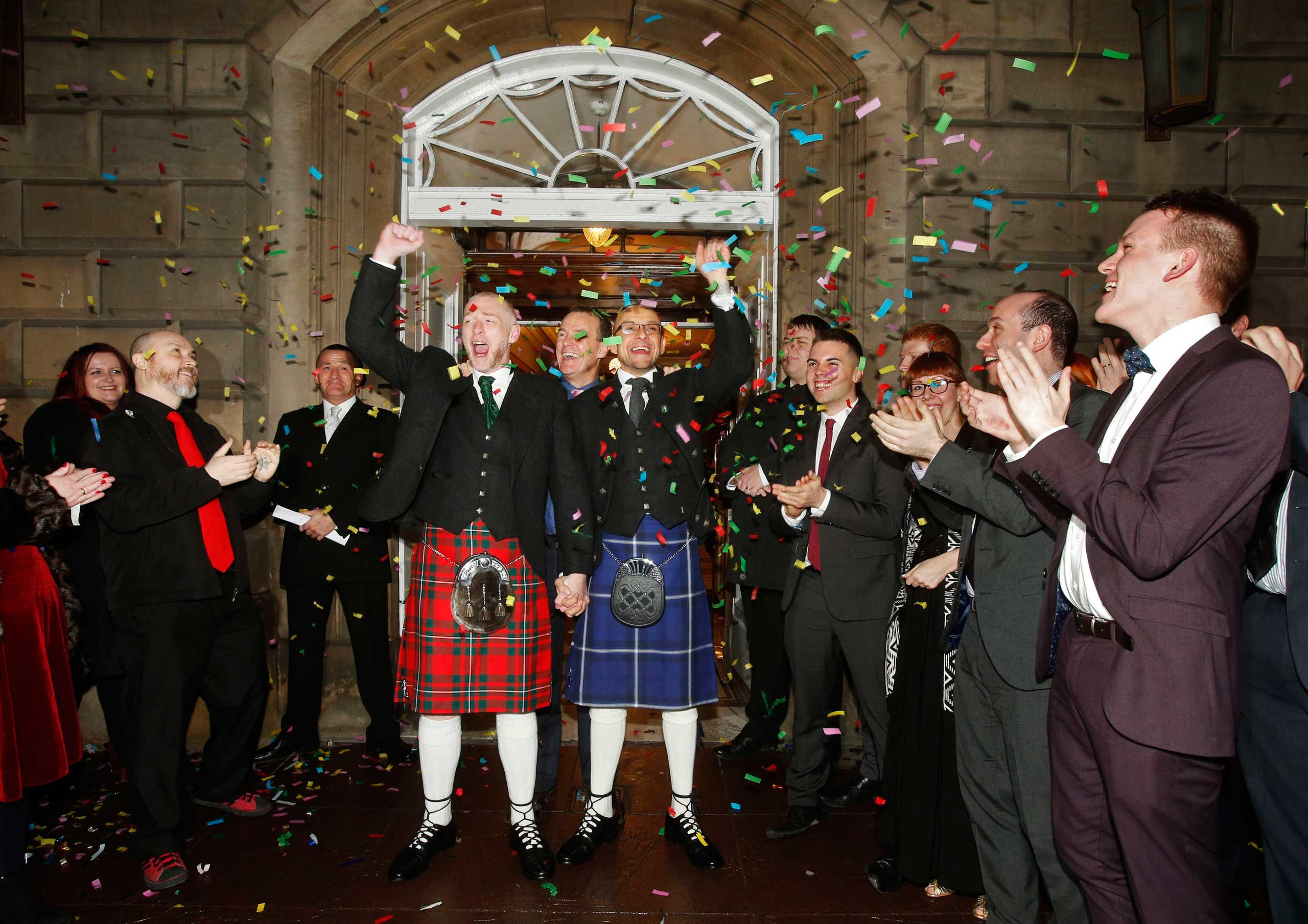 Malcolm Brown (left) and Joe Schofield, both 42, after they were married in Glasgow, UK, in one of Scotland's first same-sex weddings.