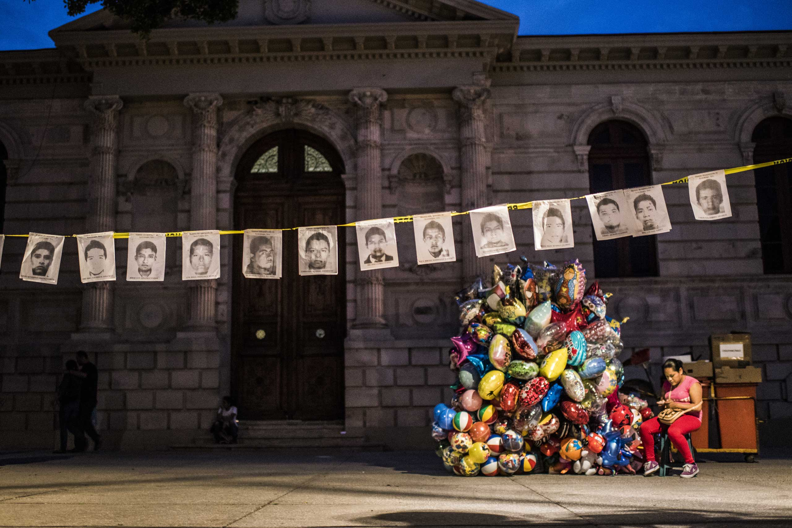 Portraits of 43 missing students allegedly abducted and killed by a drug gang, aided by corrupt police officers, in Mexico's Southern Guerrero state. hang in the main square of Chilpancingo de los Bravo, the capital of Guerrero State where the drug cartels operate with impunity, Oct. 31, 2014.