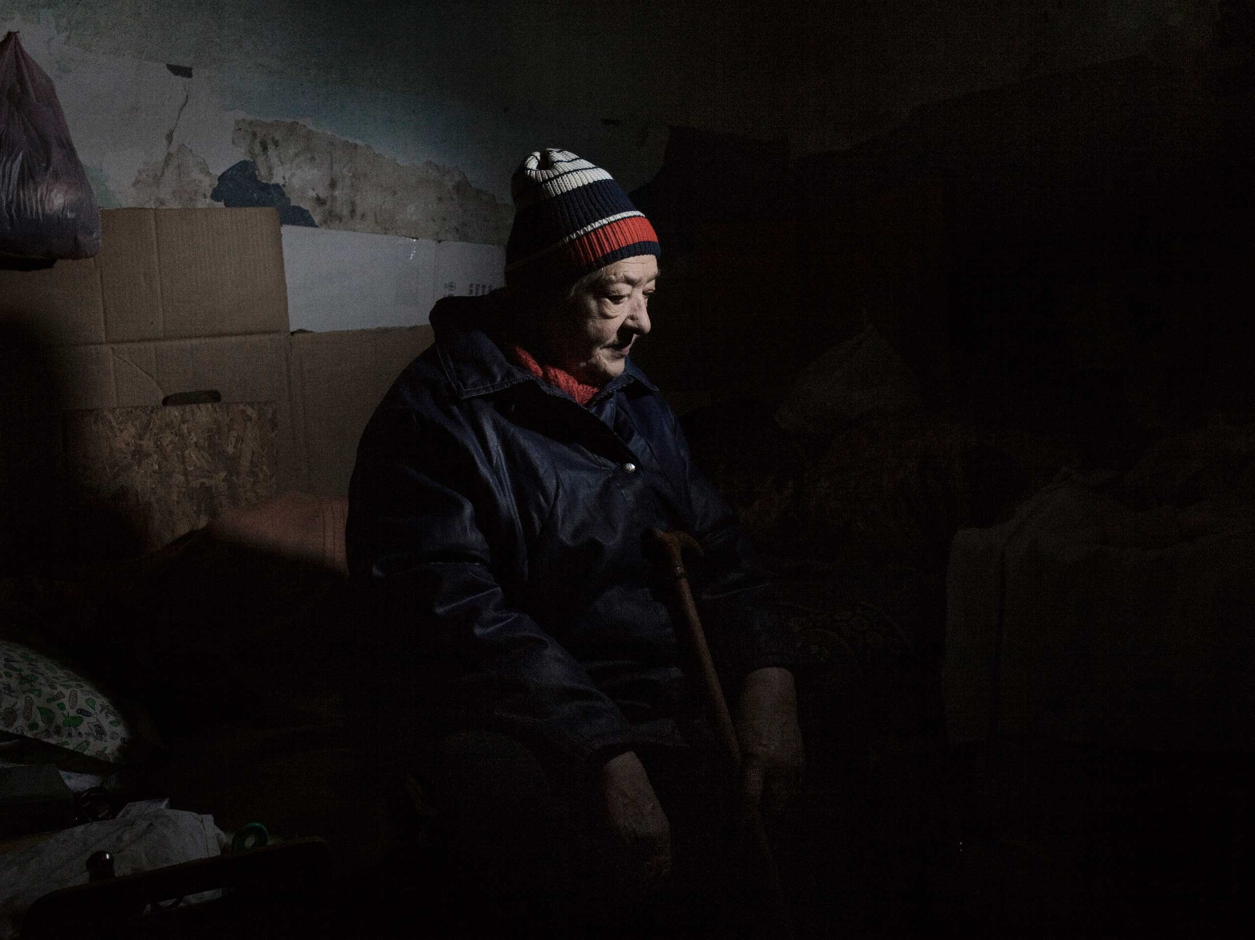 An elderly woman living in a bomb shelter in the Kievsky neighborhood near the embattled airport. Donetsk, Ukraine. Nov. 20, 2014.