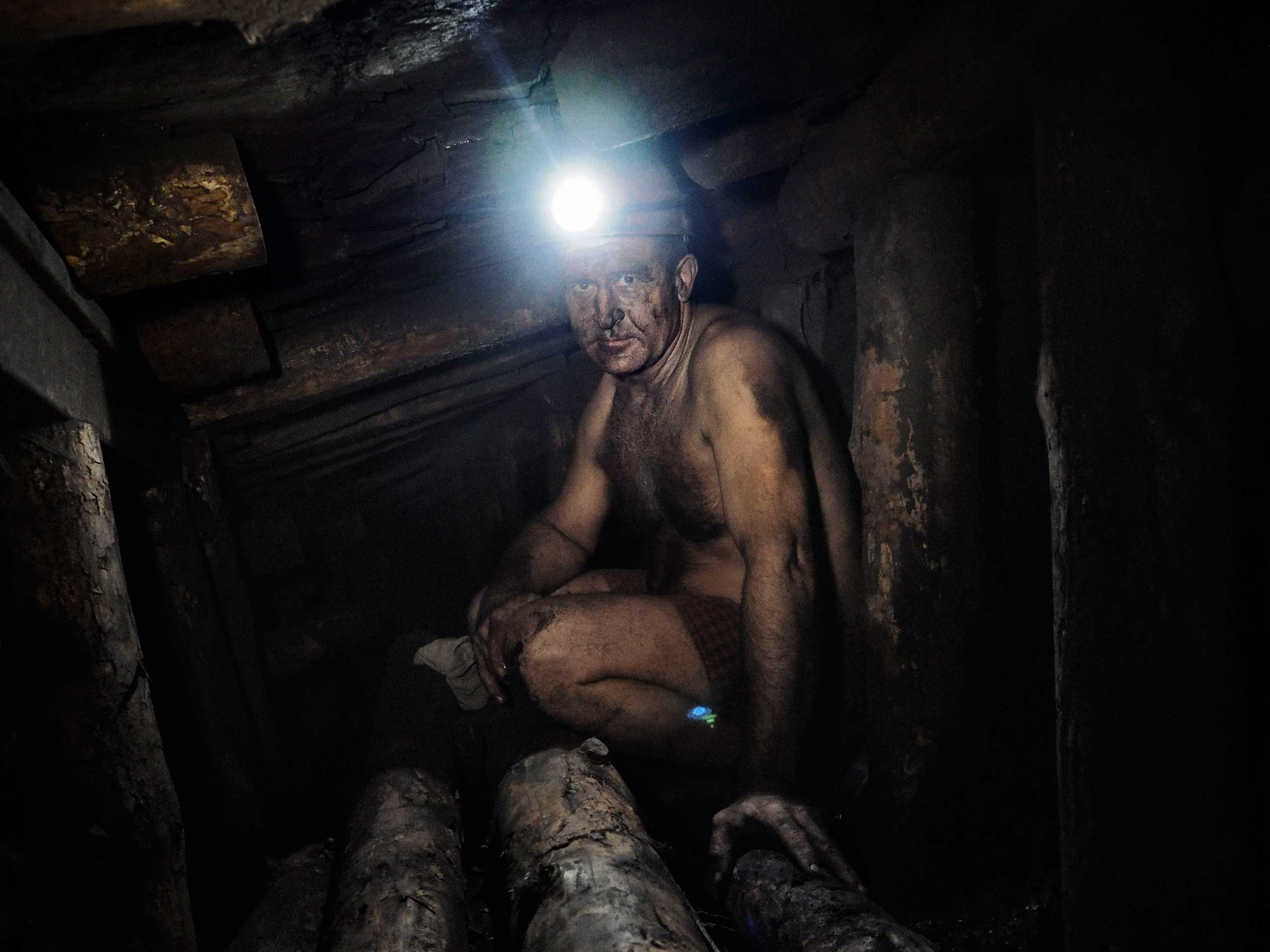 A miner works in a very hot part of the deepest shaft. Minutes later, he was told to evacuate. Petrovskyi district, Donetsk, Ukraine. Nov. 22, 2014.