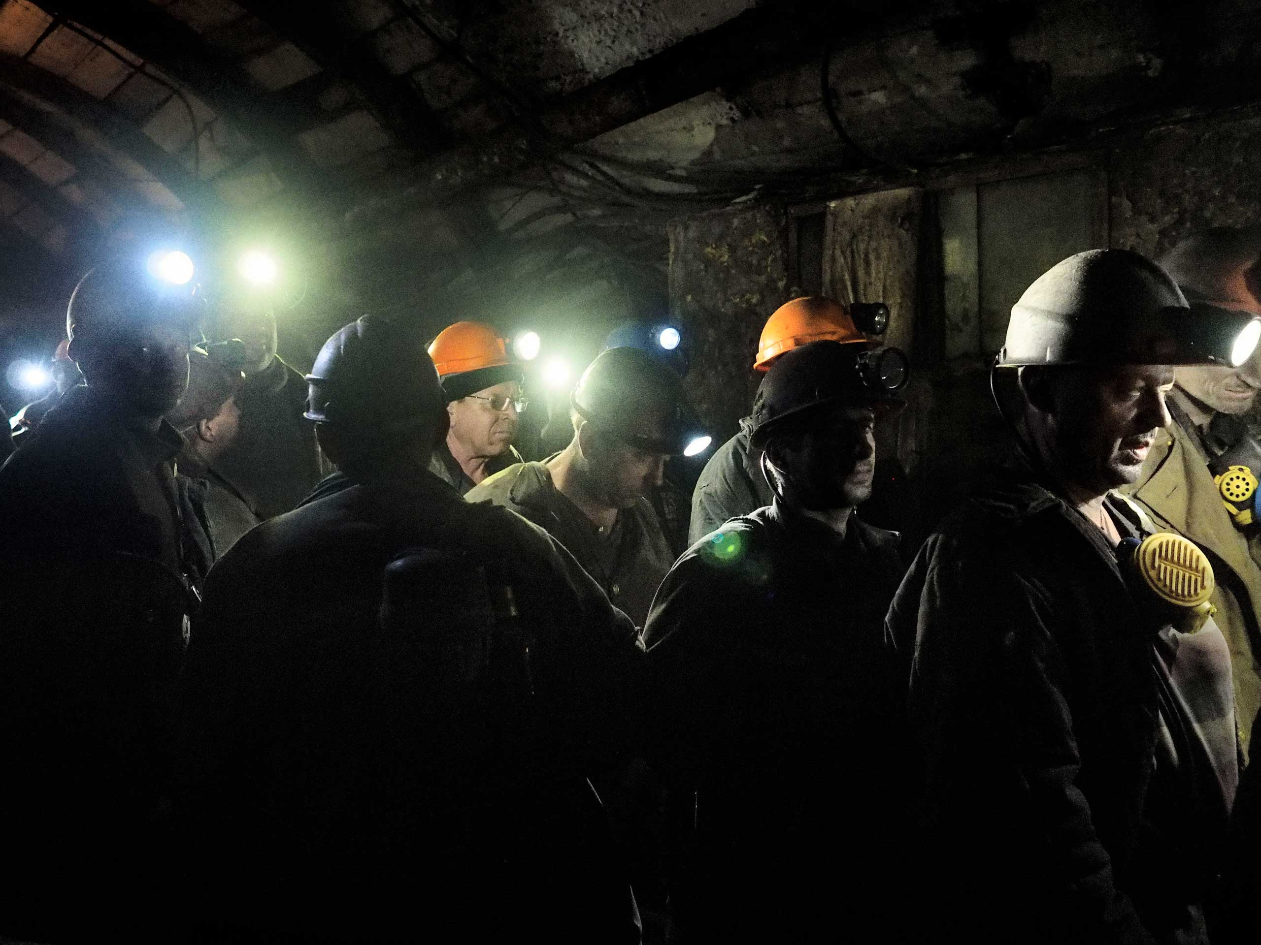 A group of miners on the way to the cable car during the evacuation. Petrovskyi district, Donetsk, Ukraine. Nov. 22, 2014.