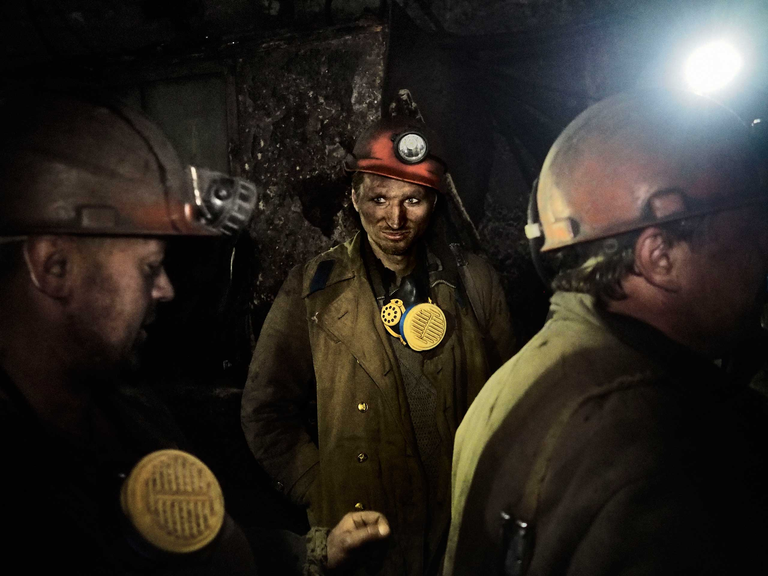 A group of miners wait for a cable car while evacuating the mine's deepest shaft. Petrovskyi district, Donetsk, Ukraine. Nov. 22, 2014.