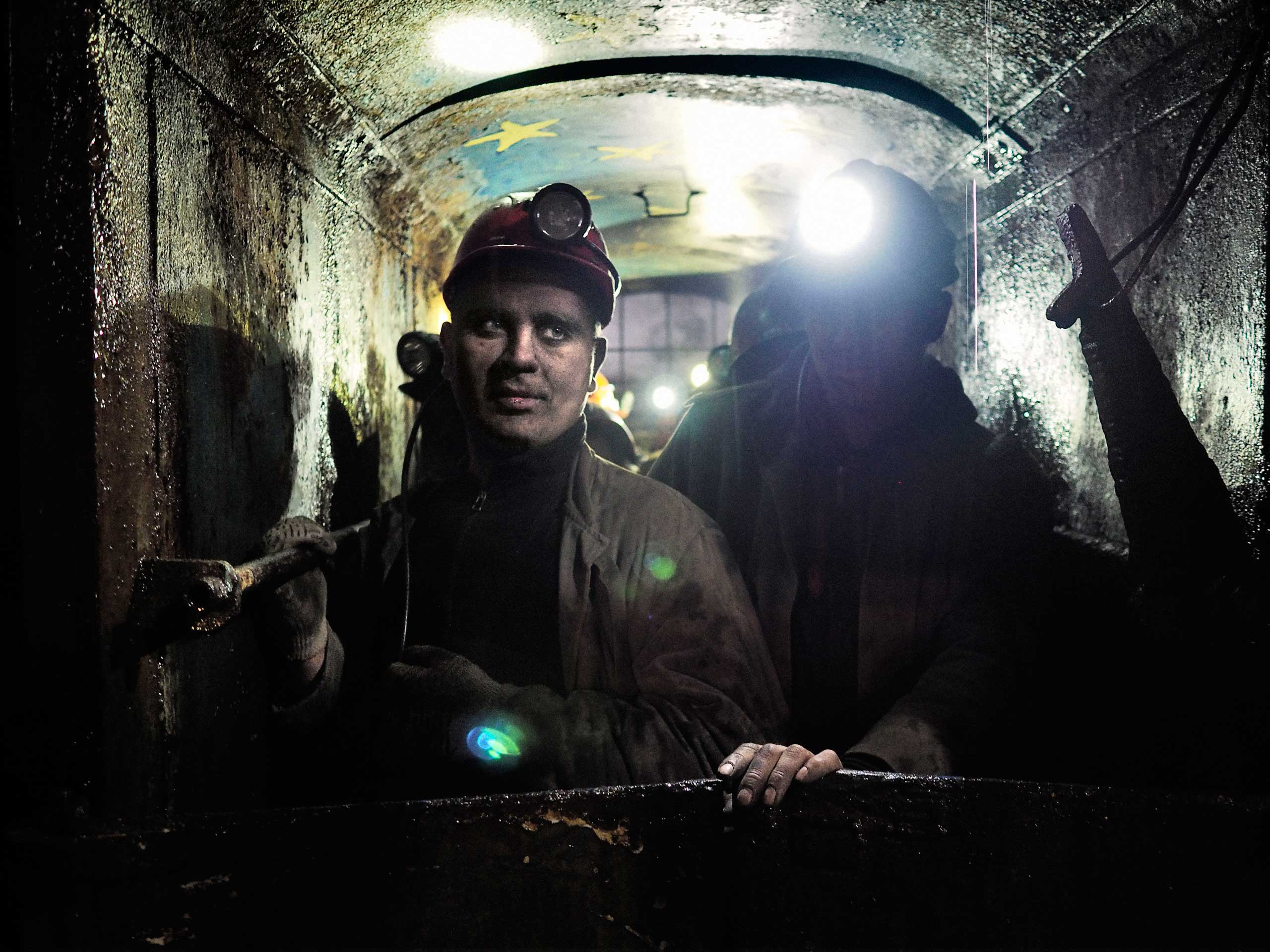 Miners at the Chelyuskintsev coal mine ride in an elevator toward ground level. Petrovskyi district, Donetsk, Ukraine. Nov. 24, 2014.