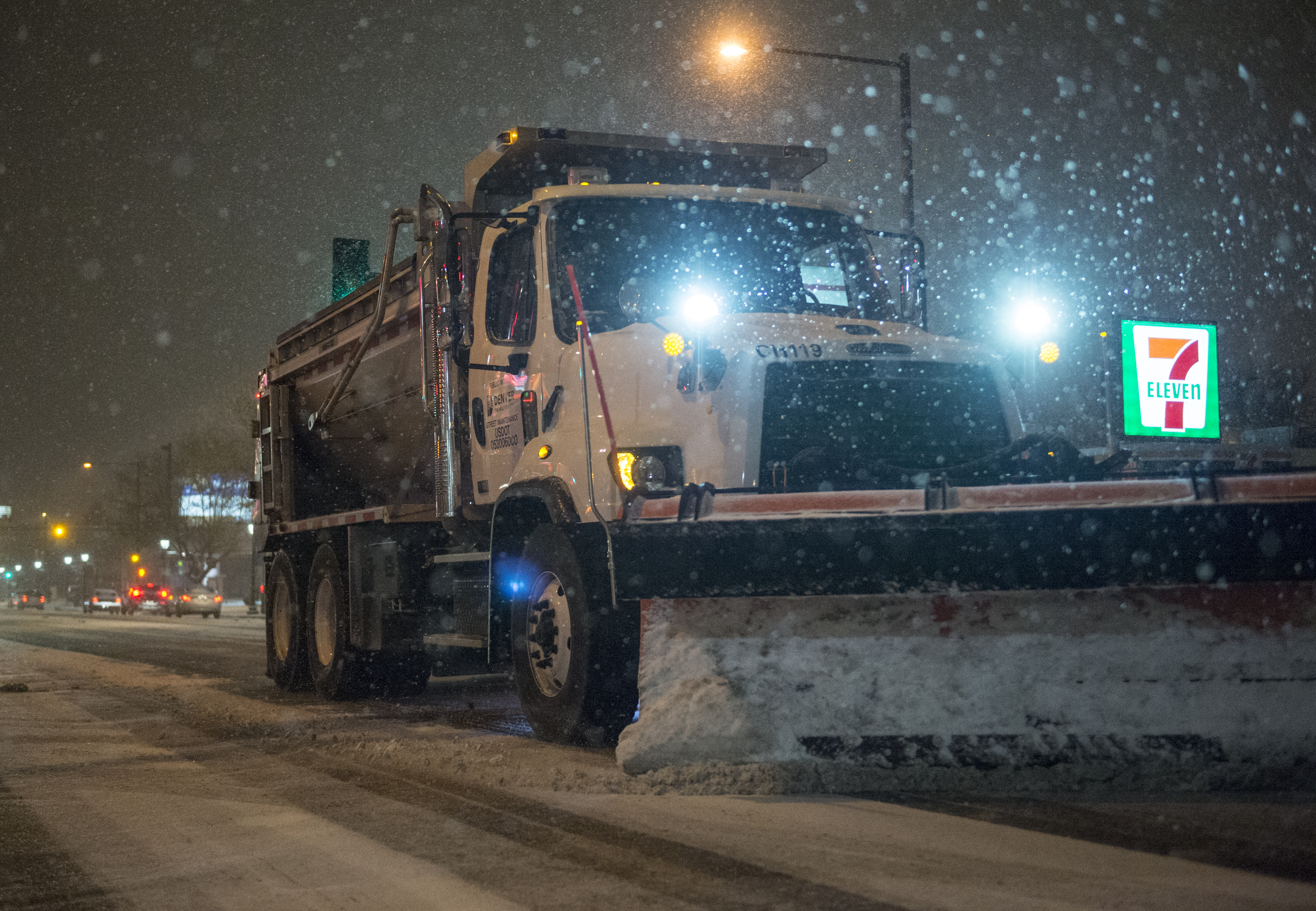 A snow plow clears the streets on Dec. 24, 2014 in Denver.