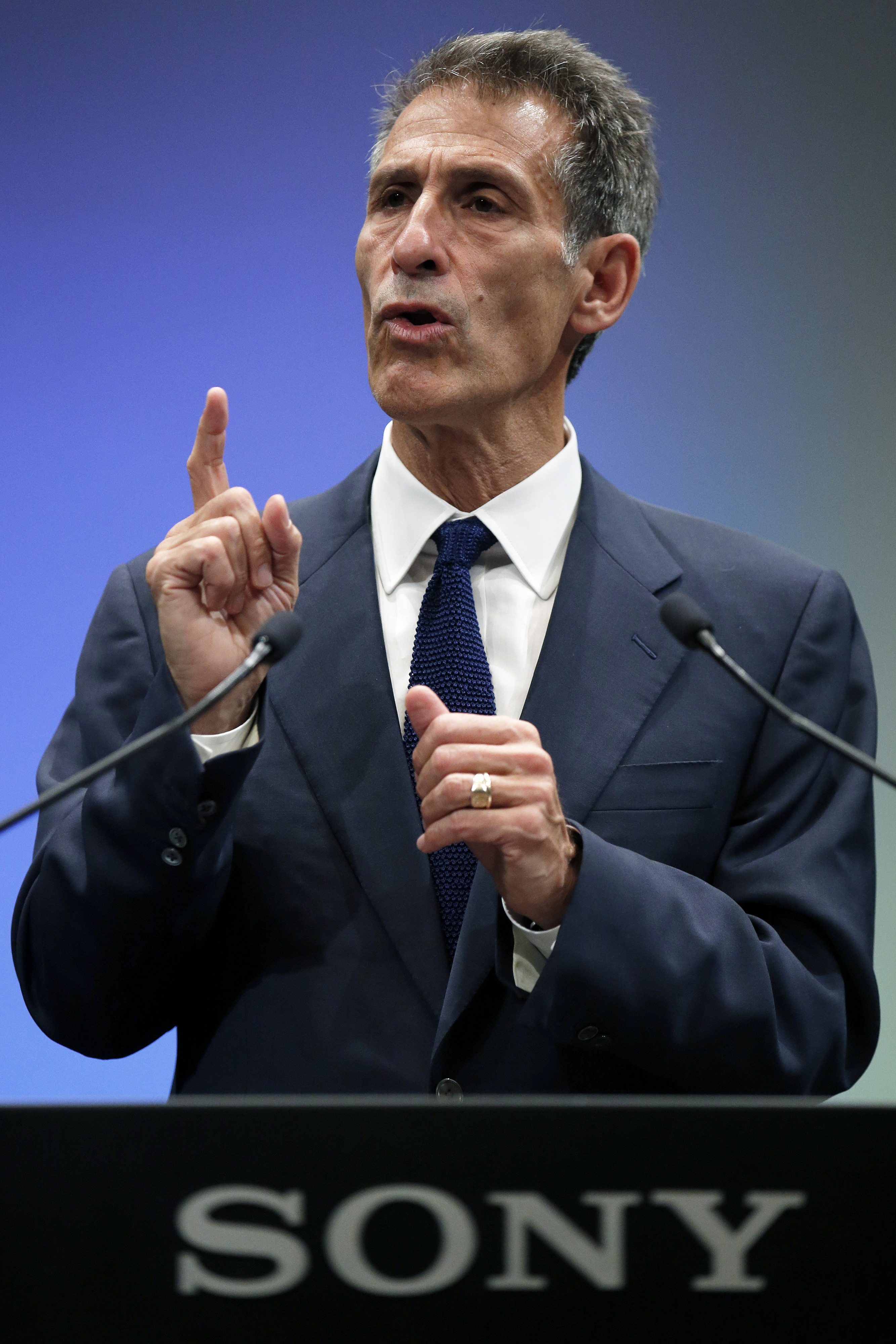 Michael Lynton, chief executive officer of Sony Pictures Entertainment Inc., gestures as he speaks during a news conference in Tokyo, Japan, on Nov. 18, 2014.