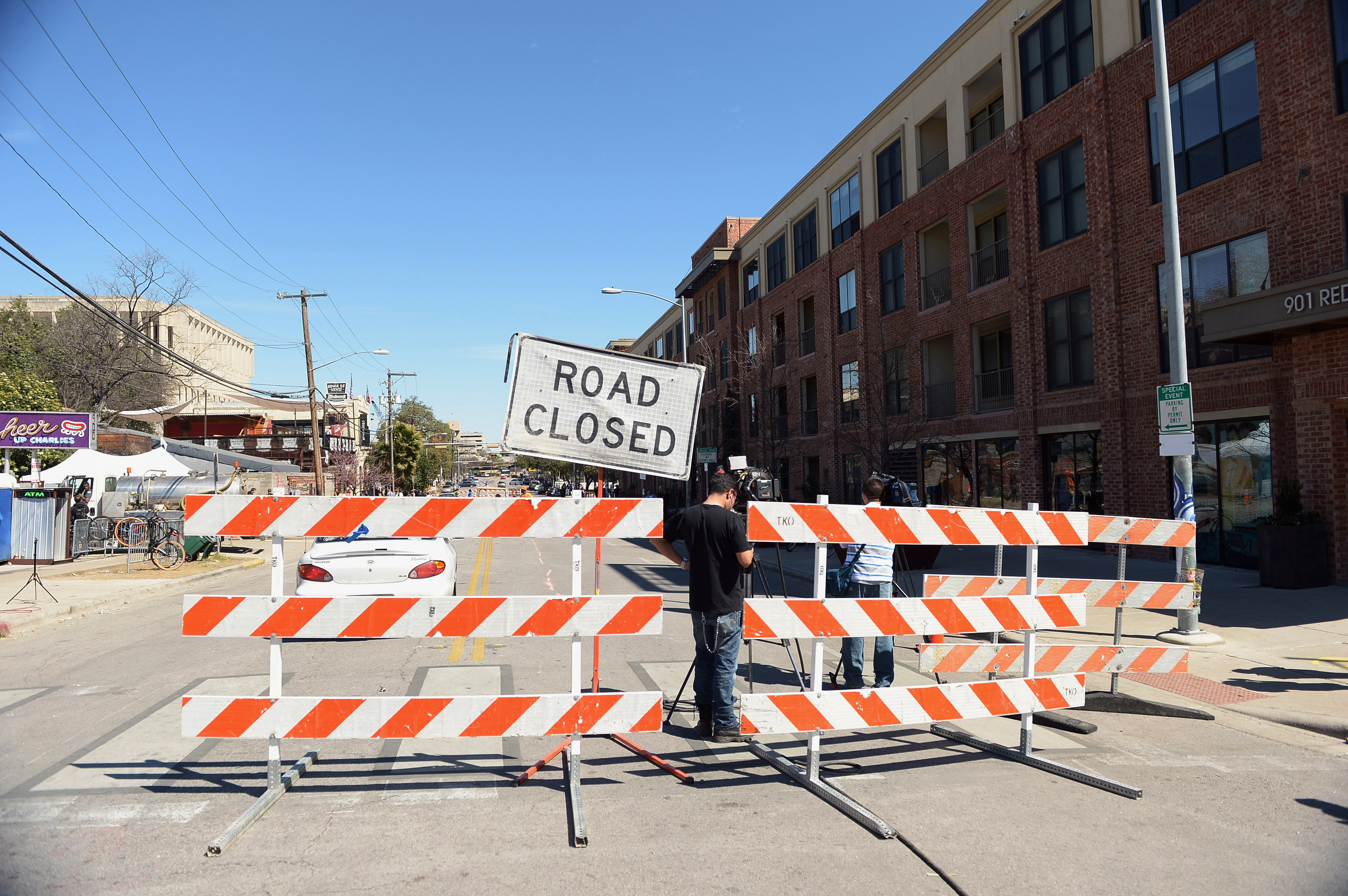 Barricades stand near the scene of a deadly car accident at the South by Southwest Music, Film and Interactive Festival on March 13, 2014 in Austin.