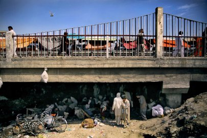 A view of Pul-e Sukhta bridge from the banks of the dried Kabul river on Aug. 26, 2014. While hundreds, often thousands, of addicts swarm below in a self-fueling network of drugs, crime and despair, life seems to continue unaffected above.