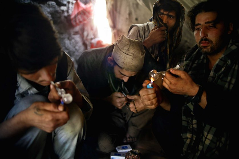 Beneath the Pul-e Sukhta bridge in Western Kabul a group of Pakistani heroin addicts take refuge from the summer sun, huddled within a tent - smoking, injecting and sleeping in a putrid squalor. Pictured above are Emal, Rahim, Ajmal and Wahid (left to right) who have been sharing a tent for the past two weeks.