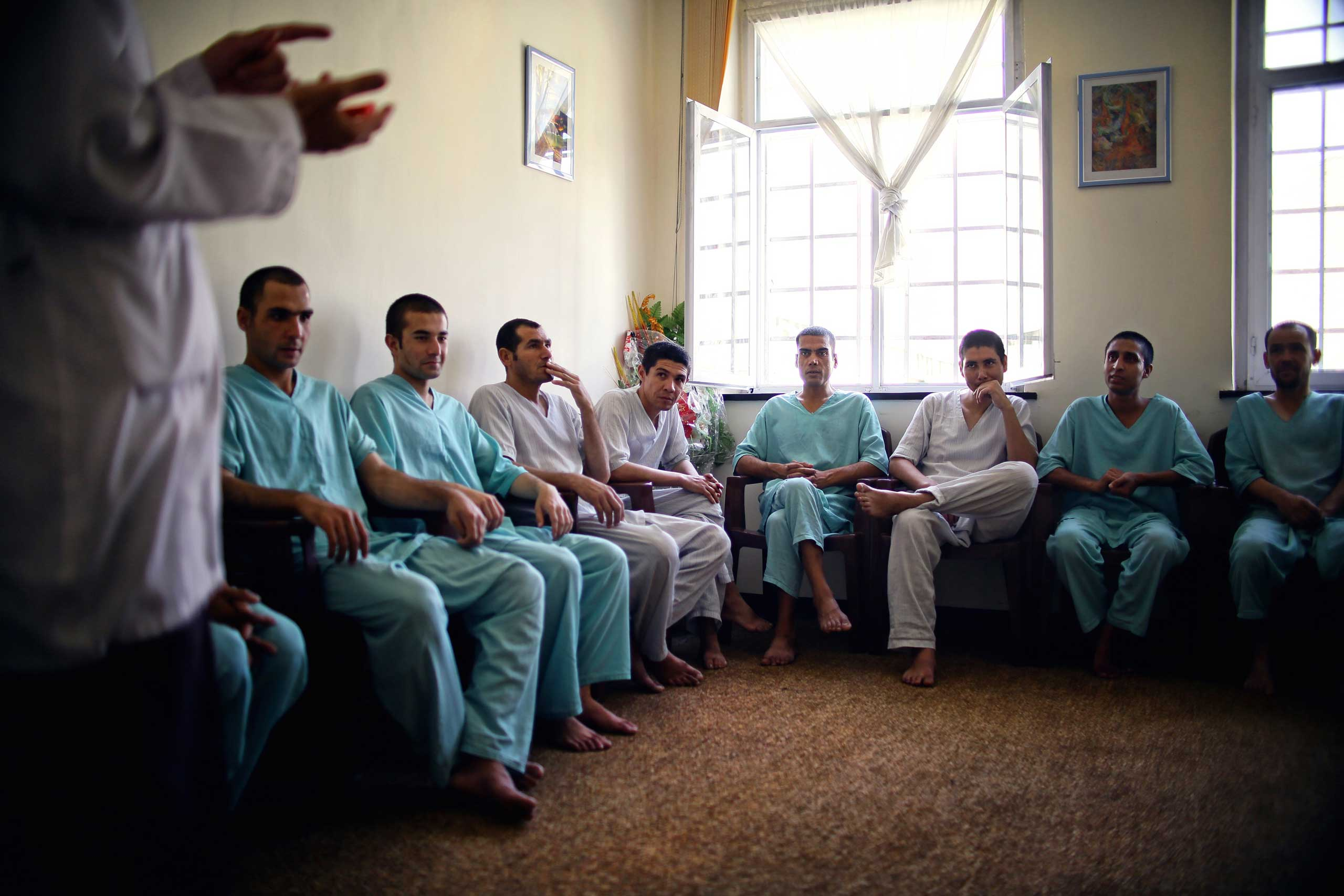 Recovering addicts attend a group counseling session at the government run Jangalak rehabilitation centre in Kabul on Aug. 24, 2014.
