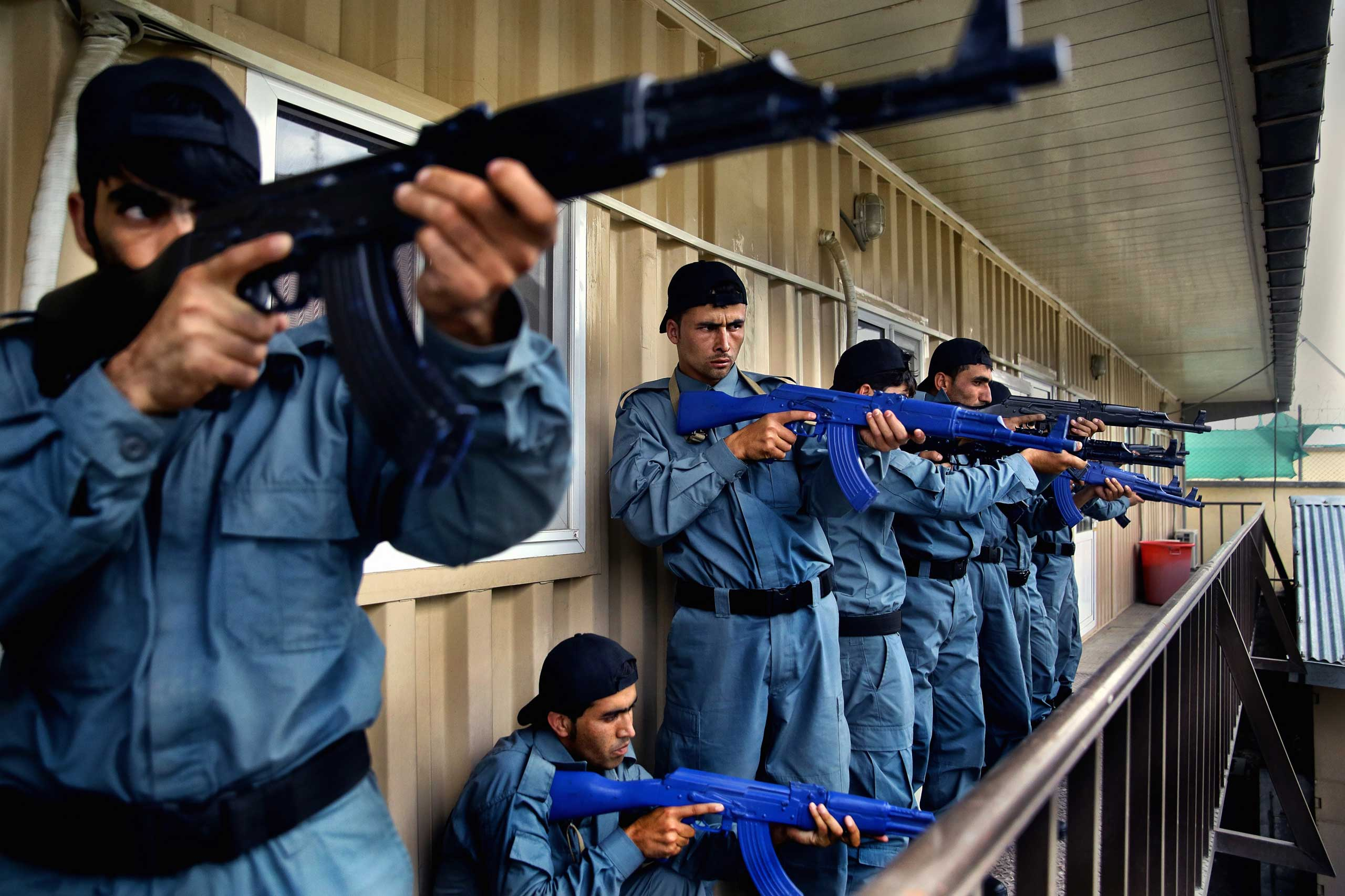 Afghan National Police officers from the Anti-Narcotics Quick Reaction Force (ANQRF) carry out a raid scenario exercise intended for drug traffickers at a training centre in Kabul on Aug. 25, 2014.