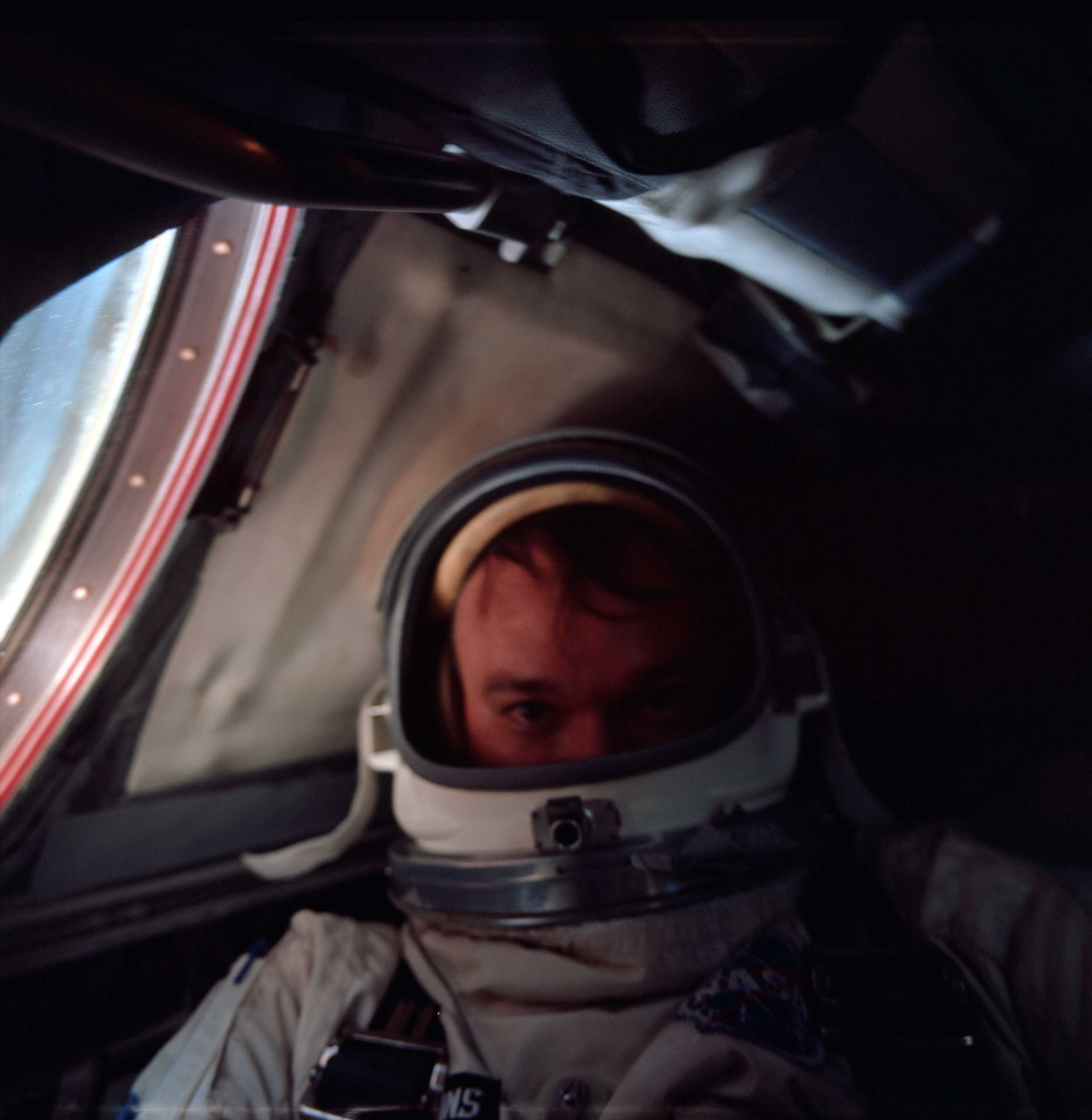 Gemini 10 astronaut Mike Collins takes a selfie in July 1966.