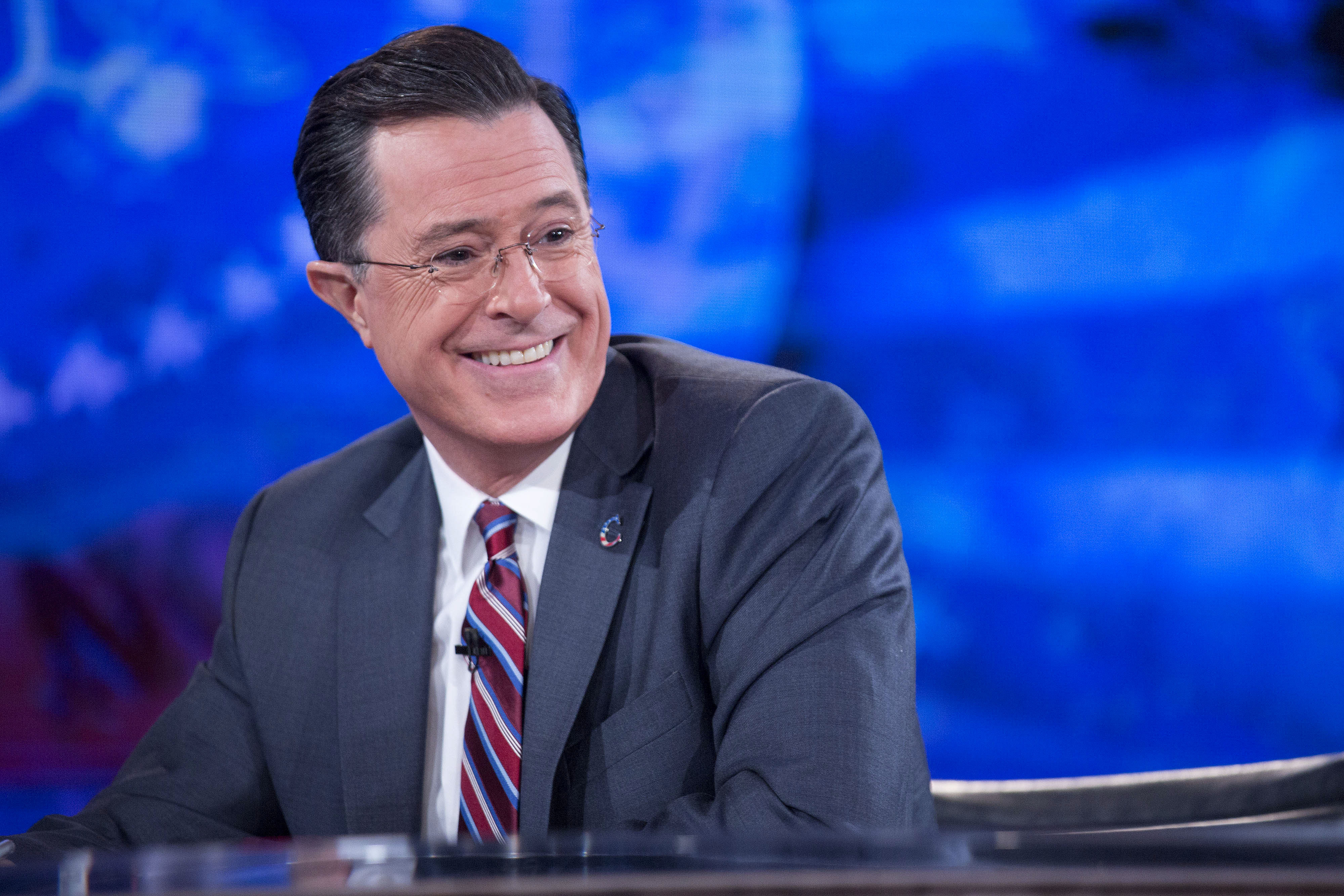 Television personality Stephen Colbert smiles while taping the  The Colbert Report  on Dec. 8, 2014.