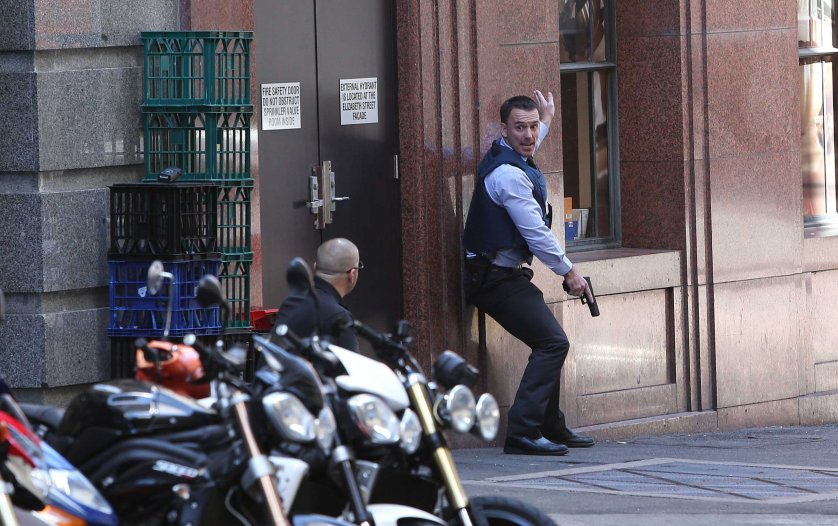 Heavily armed specialist police officers during a siege at Martin Place in the CBD while hostages are held at gunpoint at the Lindt cafe in Sydney, Dec. 15, 2014.