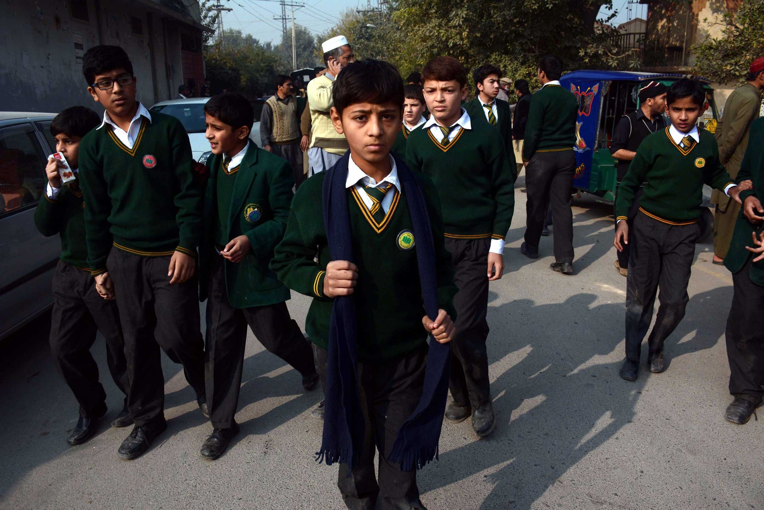 School children rescued by Pakistani security forces leave following an attack at the Army run school, in Peshawar on Dec. 16, 2014.