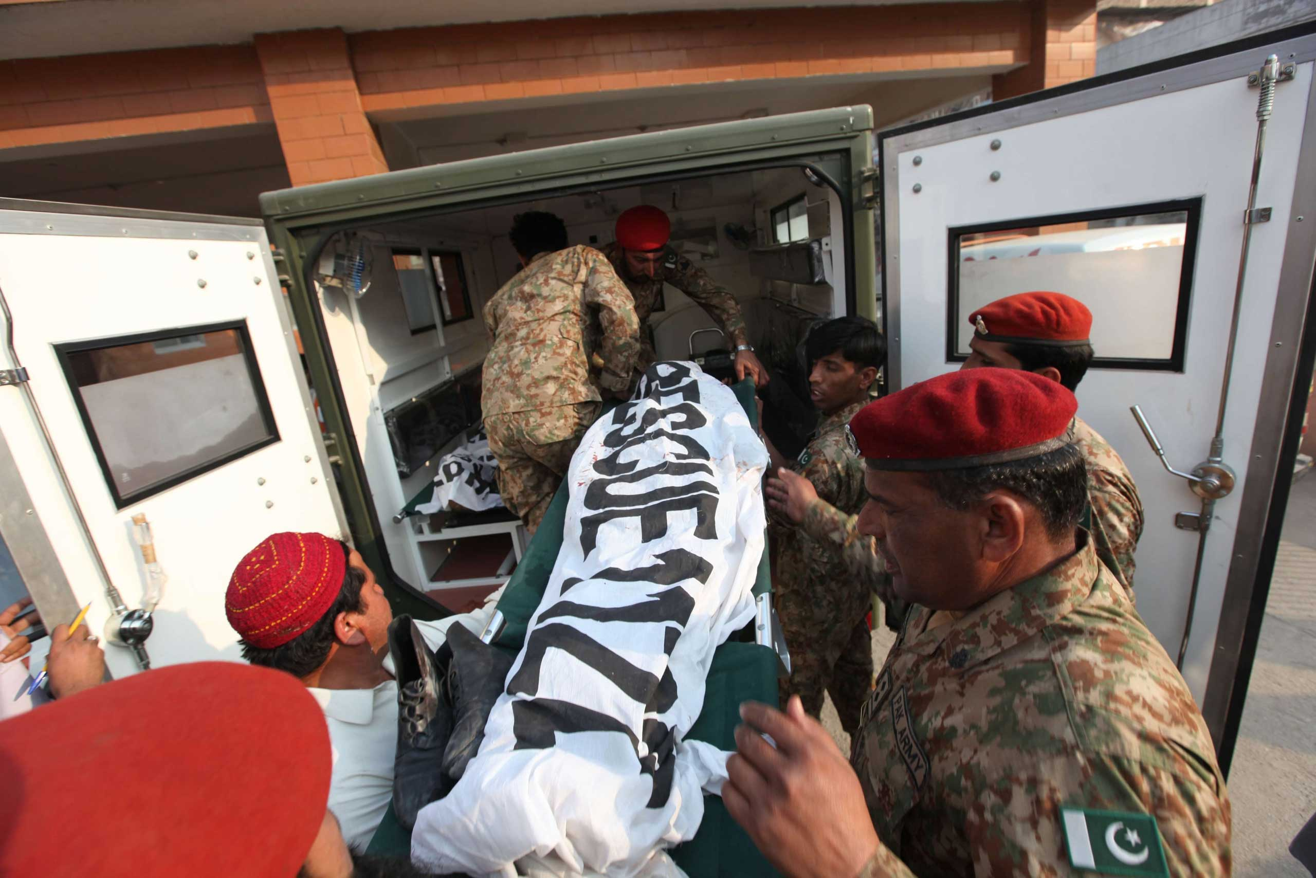 Pakistani soldiers move bodies of victims who were killed when Taliban gunmen attacked an Army run school, in Peshawar, on Dec. 16, 2014.