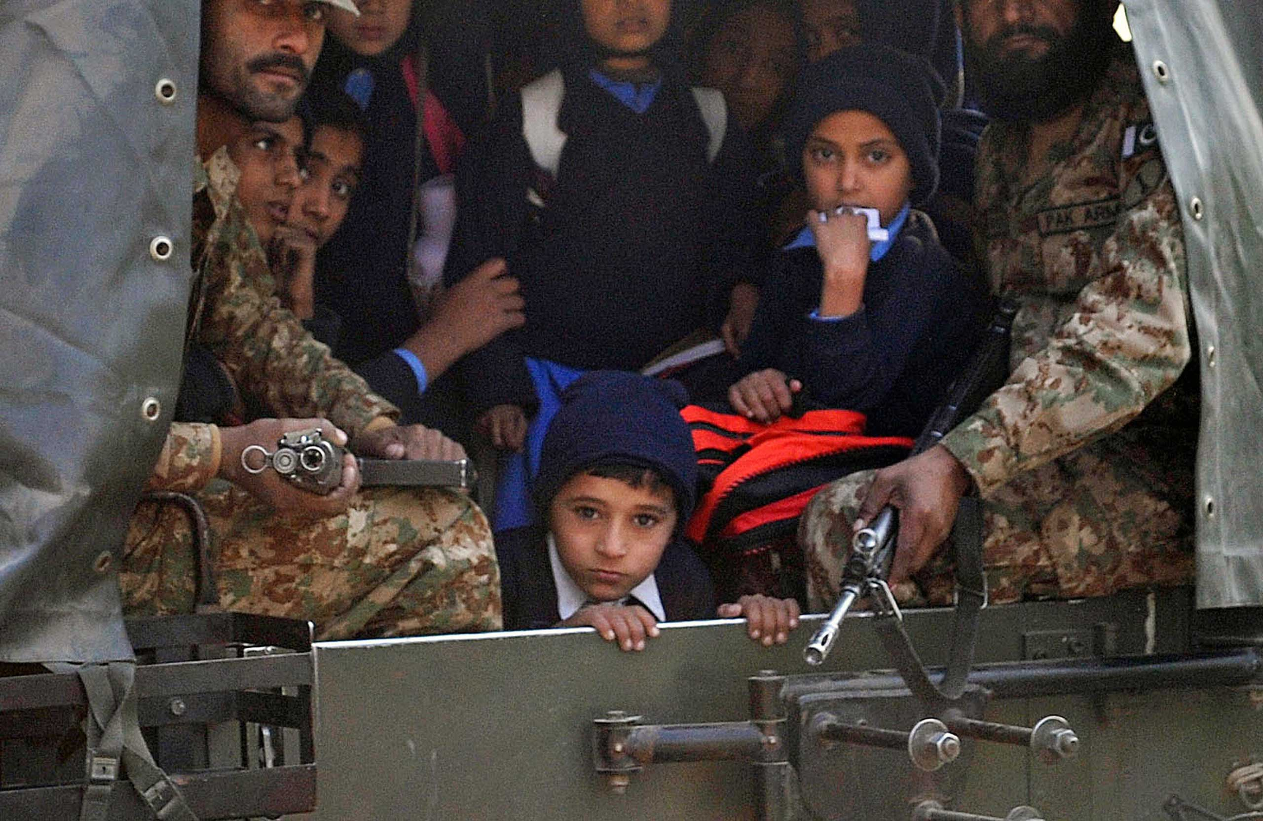 Pakistani soldiers transport rescued school children from the site of an attack by Taliban gunmen on a school in Peshawar on Dec. 16, 2014.