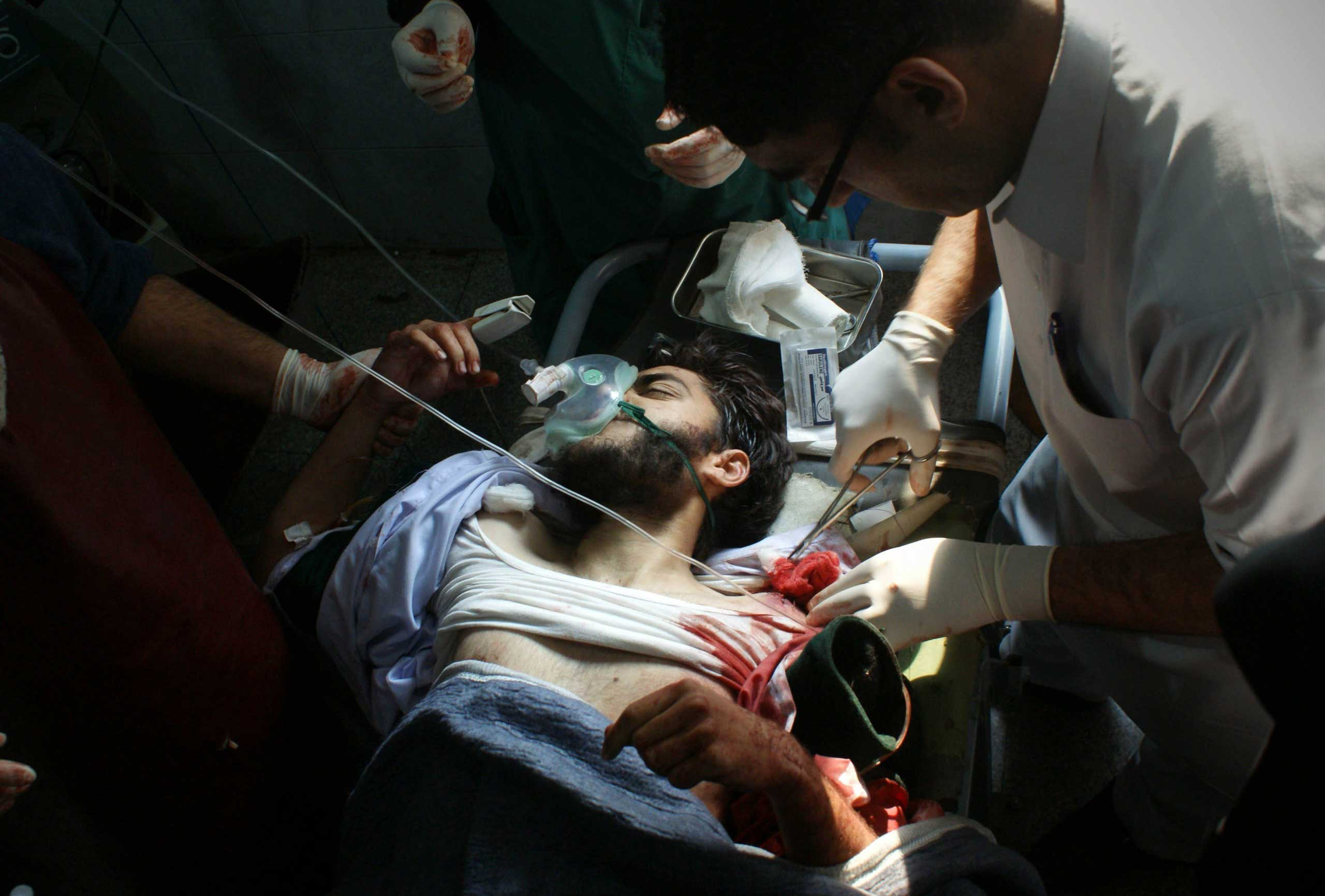A wounded Pakistani student receives treatment at a hospital following an attack by Taliban gunmen on a school in Peshawar, on Dec. 16, 2014.